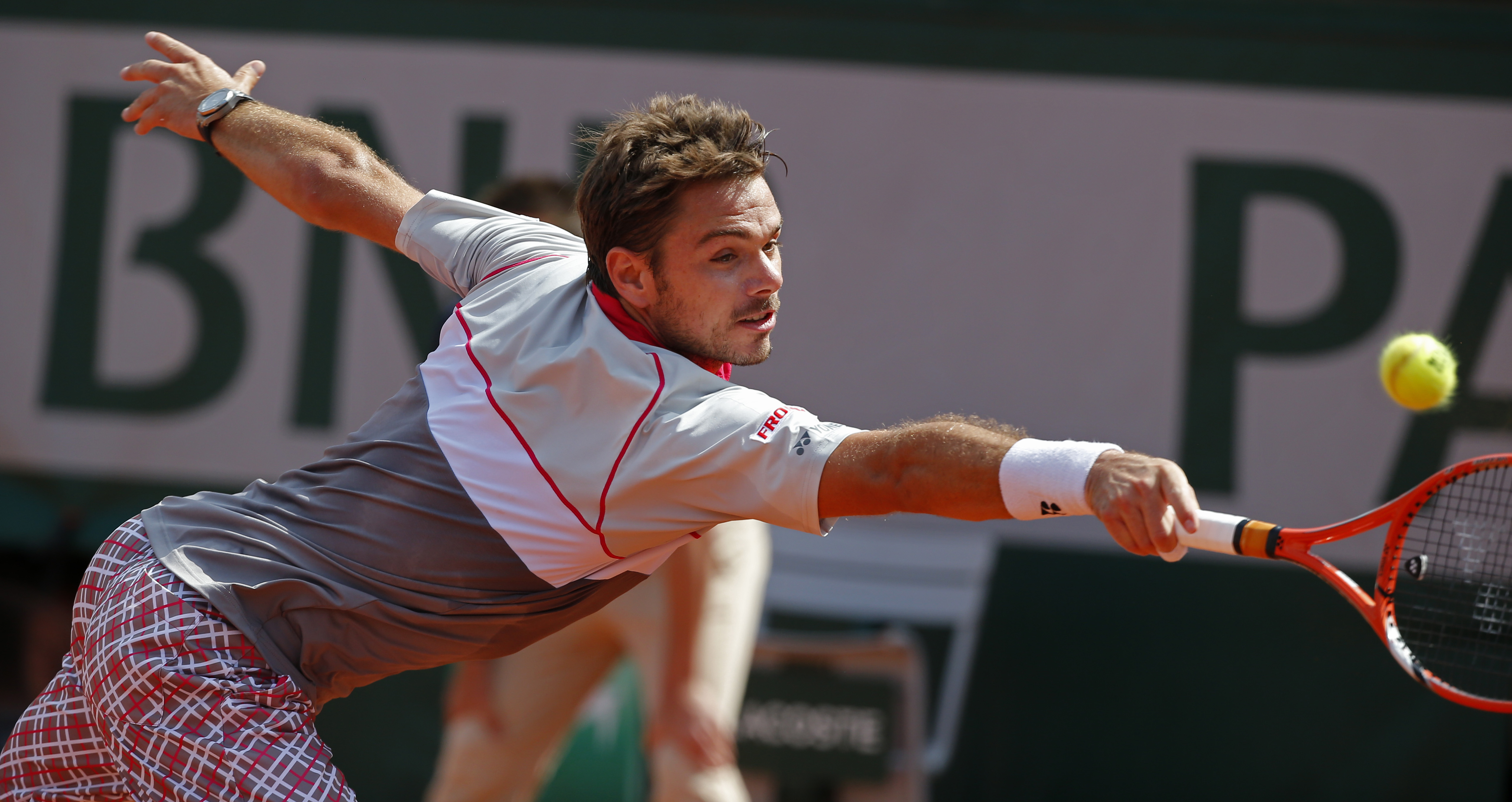 FILE - In this June 7, 2015, file photo, Switzerland's Stan Wawrinka returns in the men's final of the French Open tennis tournament against Serbia's Novak Djokovic in Paris, France. The French Open begins on Sunday, May 22, 2016.  (AP Photo/Michel Euler,