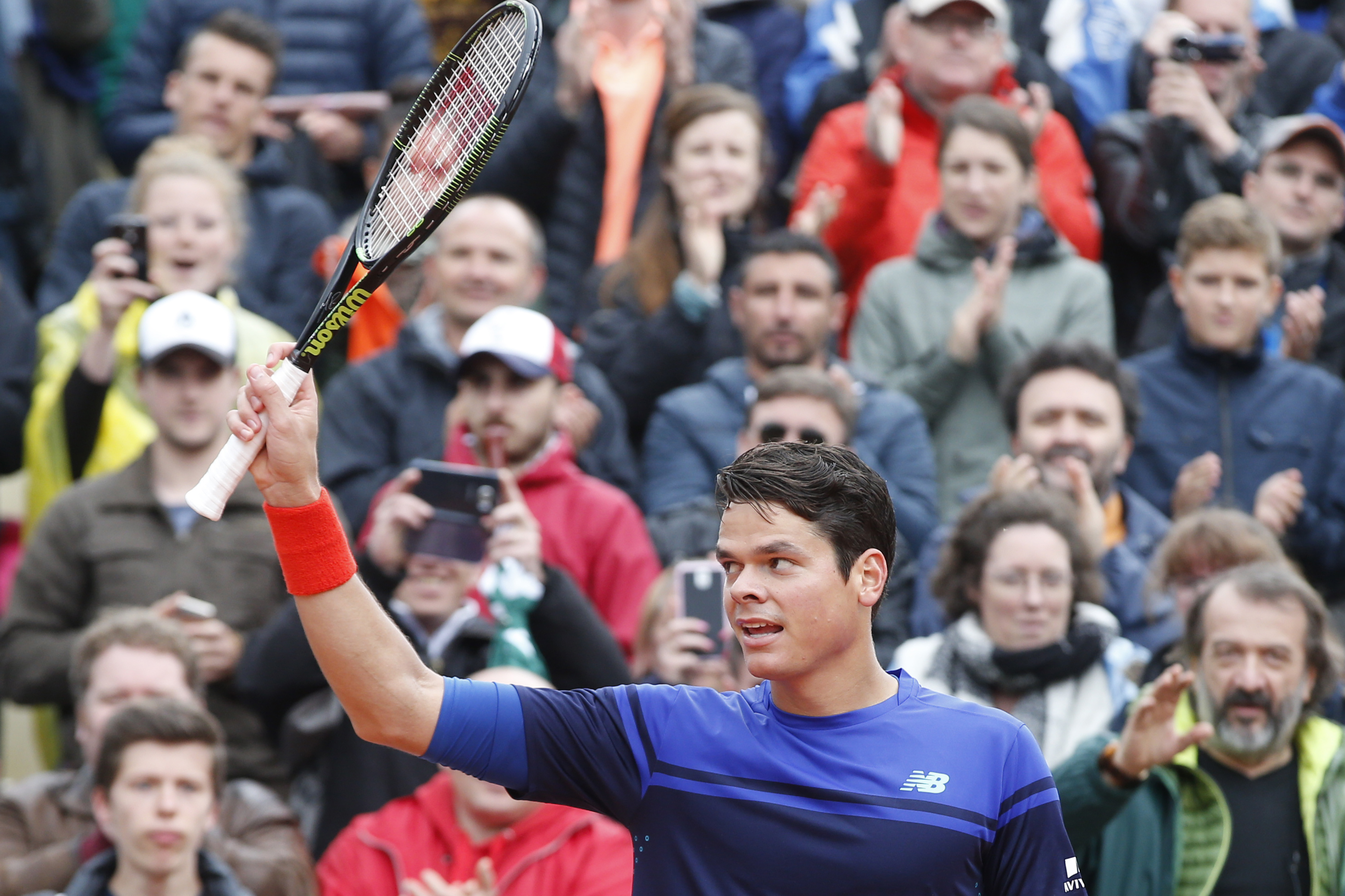 Canada's Milos Raonic greets spectators after winning his first round match of the French Open tennis tournament against Serbia's Janko Tipsarevic at Roland Garros stadium in Paris, France, Monday, May 23, 2016. (AP Photo/Alastair Grant)