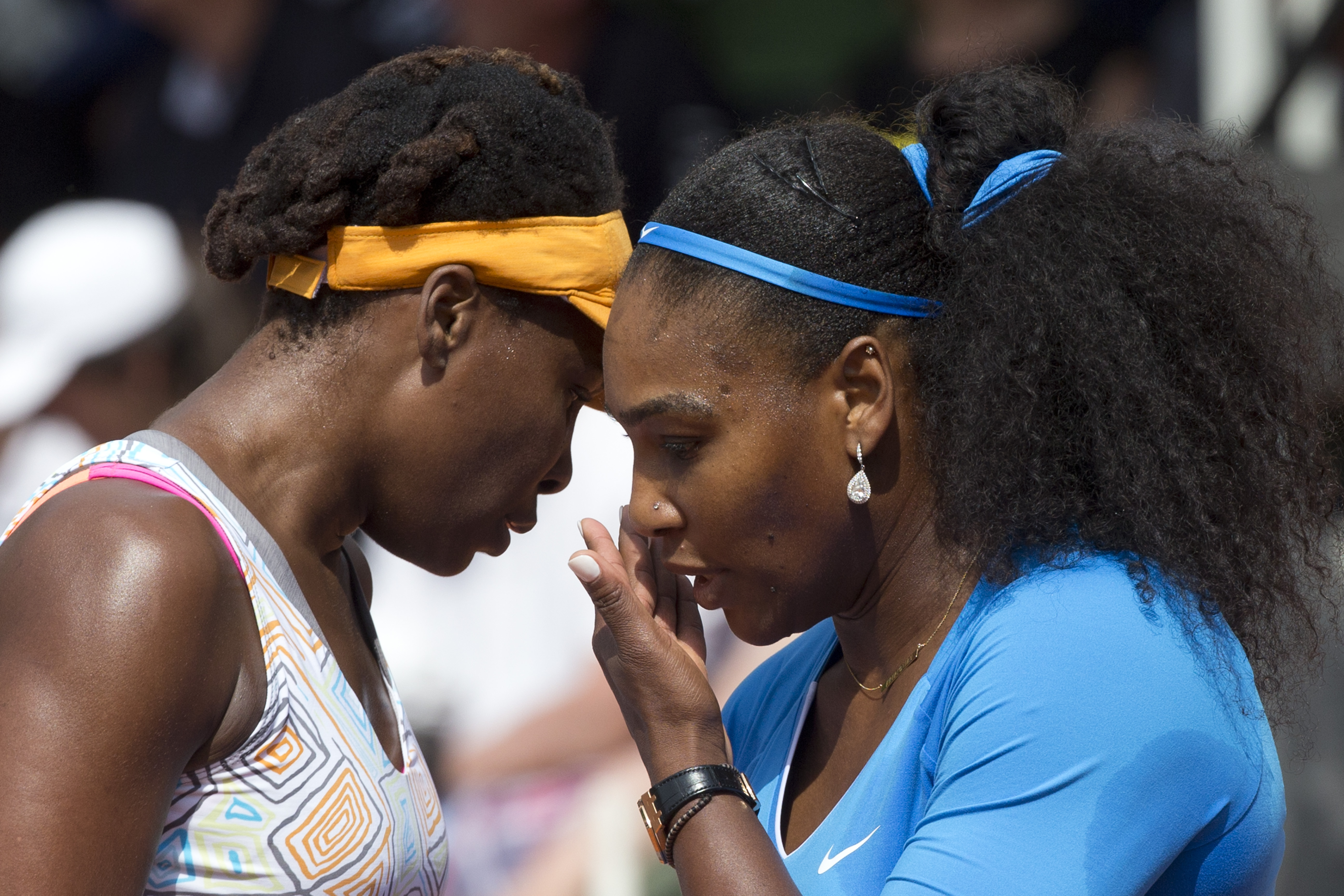 Venus, left, and Serena Williams of the U.S. talk tactics during their first round women doubles match of the French Open tennis tournament against Latvias Jelena Ostapenko and Kazakhstans Yulia Putintseva at the Roland Garros stadium in Paris, France, We