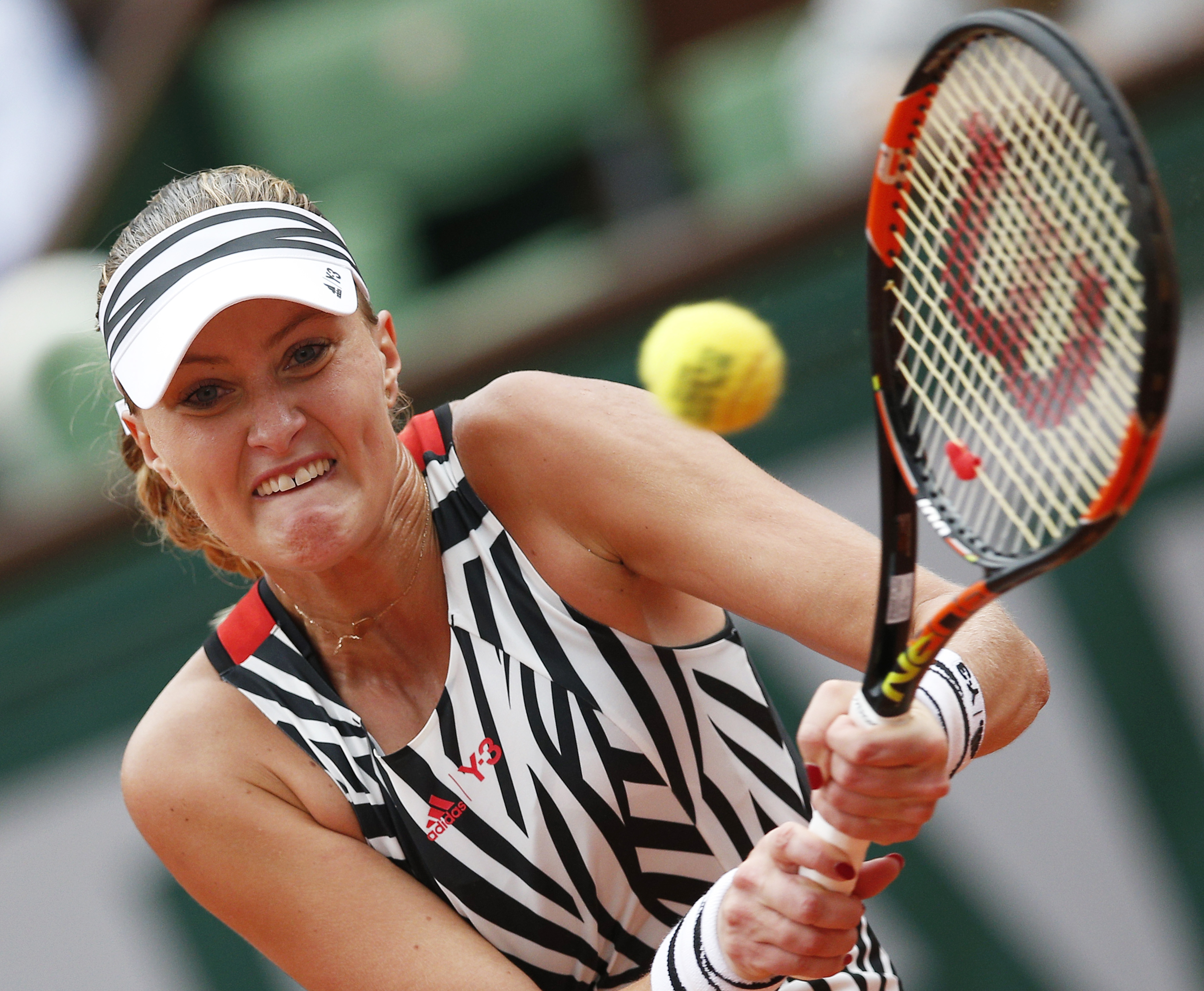 France's Kristina Mladenovic returns in the third round match of the French Open tennis tournament against Serena Williams of the U.S.  at the Roland Garros stadium in Paris, France, Saturday, May 28, 2016. (AP Photo/Christophe Ena)