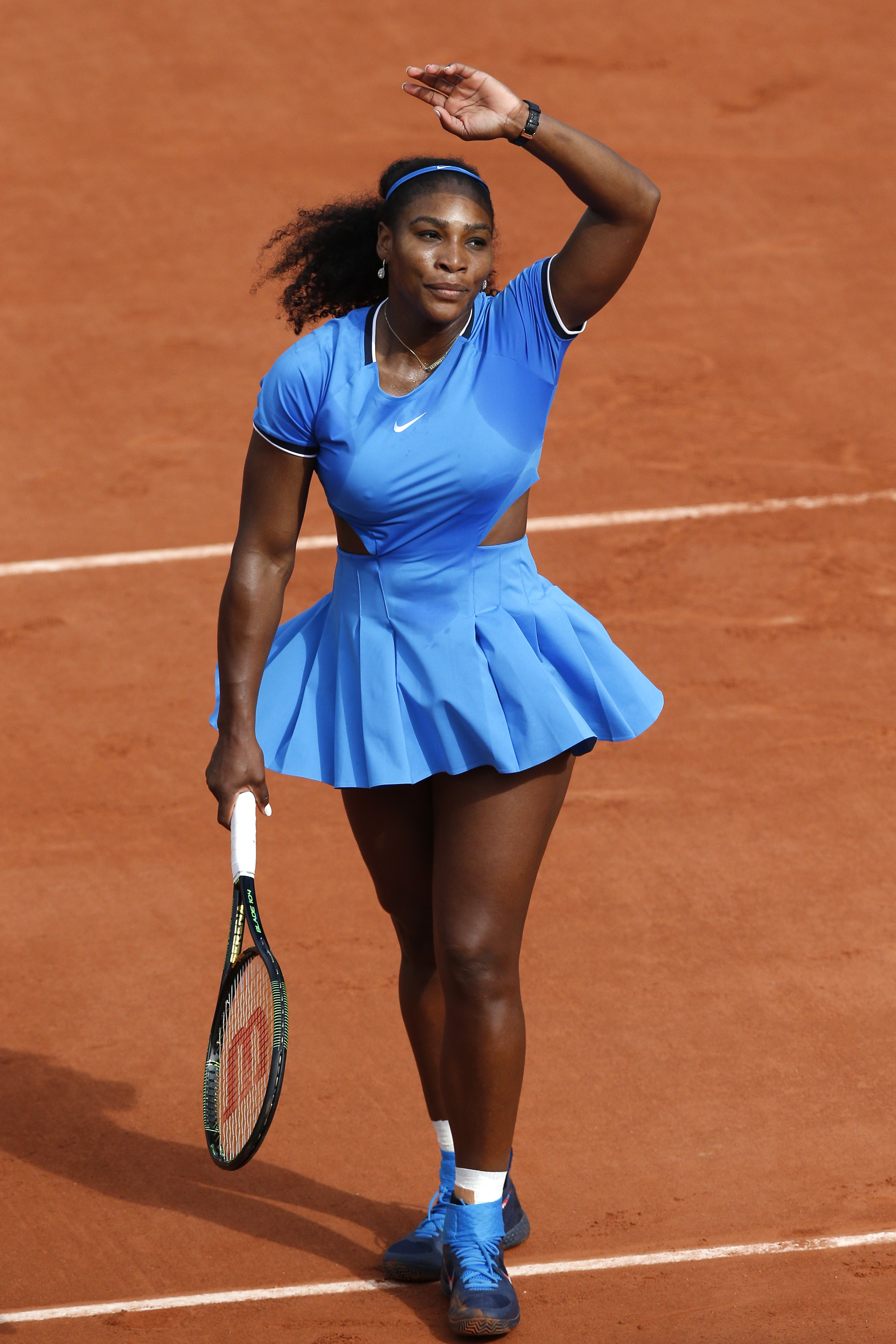 Serena Williams of the U.S. celebrates winning the third round match of the French Open tennis tournament against France's Kristina Mladenovic at the Roland Garros stadium in Paris, France, Saturday, May 28, 2016. (AP Photo/Christophe Ena)