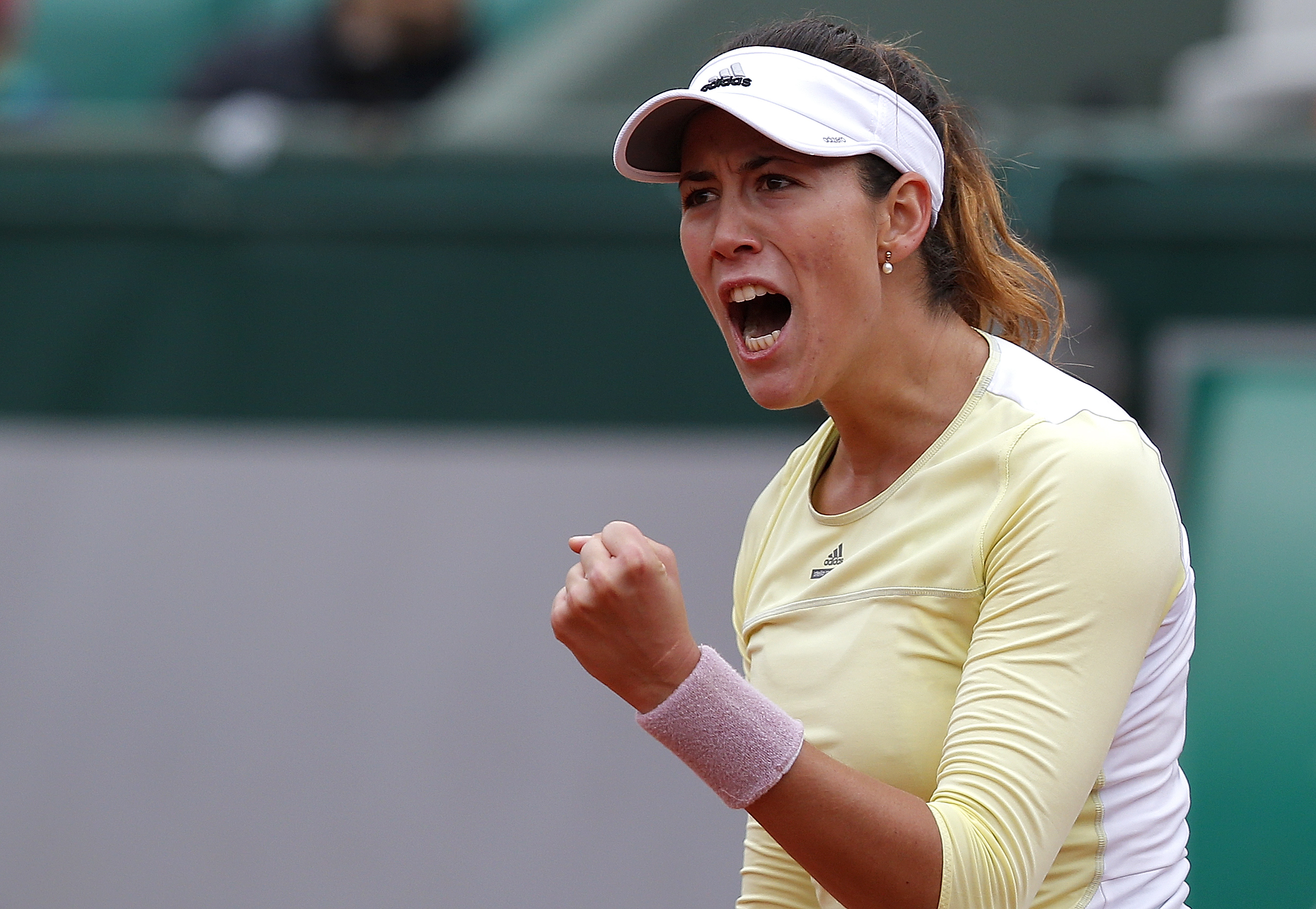 Spain's Garbine Muguruza clenches her fist  as she plays Australia's Samantha Stosur during their semifinal match of the French Open tennis tournament at the Roland Garros stadium, Friday, June 3, 2016 in Paris. (AP Photo/Michel Euler)