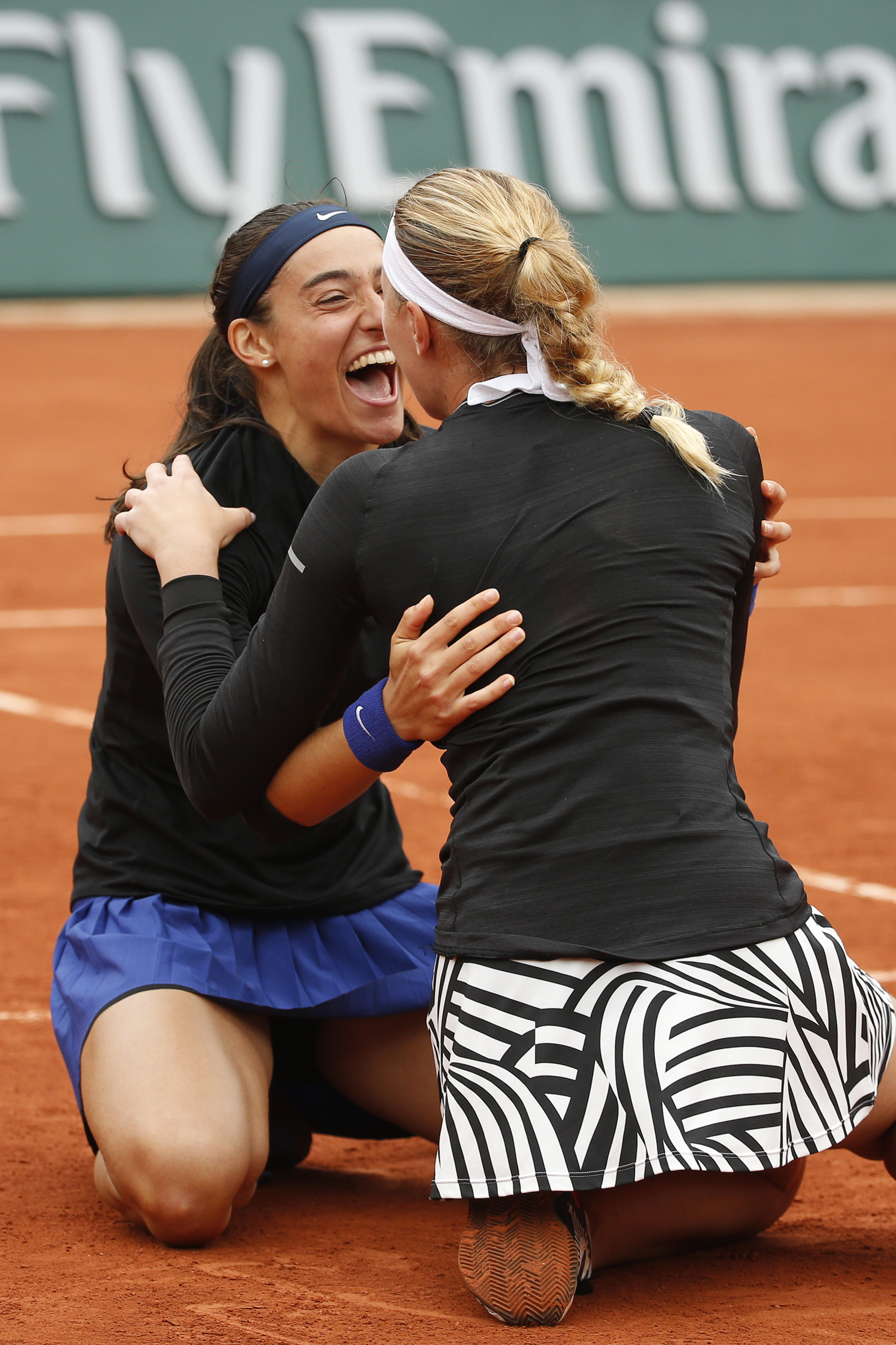 Caroline Garcia, left, and Kristina Mladenovic of France celebrate winning the women's doubles final of the French Open tennis tournament against Ekaterina Makarova and Elena Vesnina of Russia in three sets 6-3, 2-6, 6-4, at the Roland Garros stadium in P