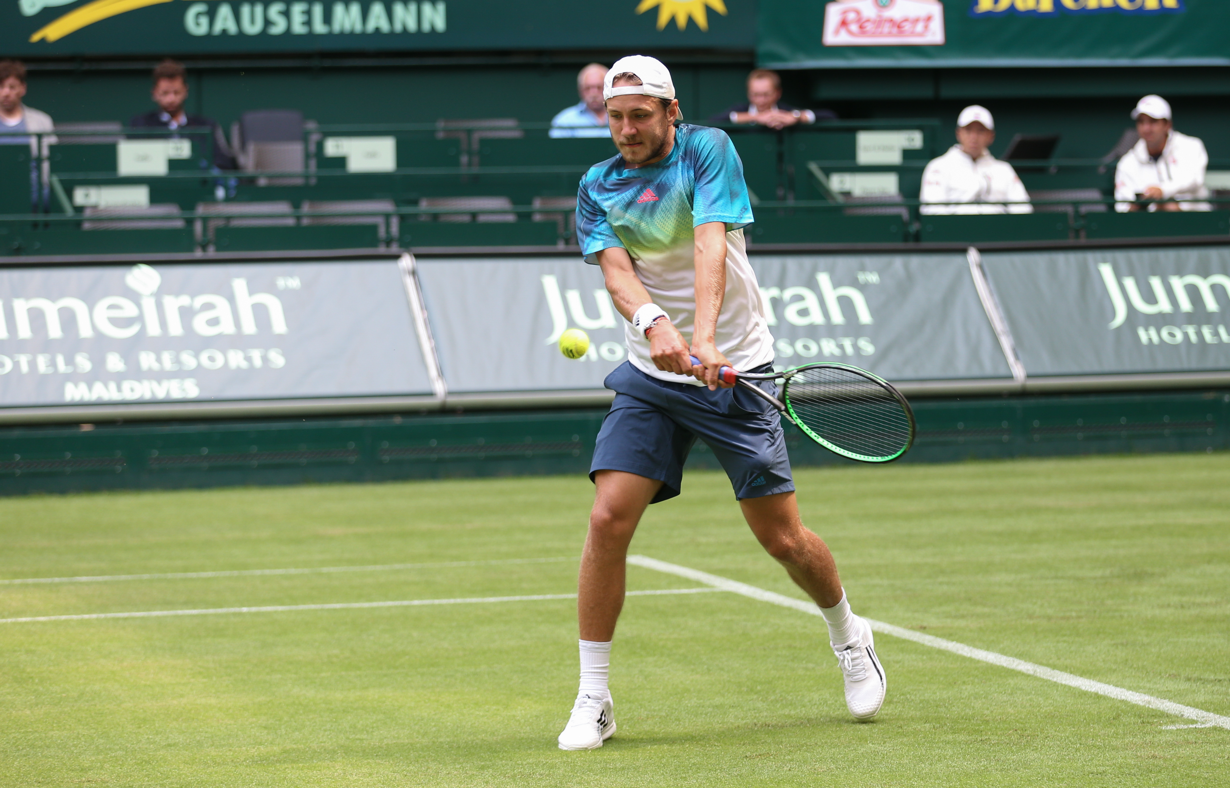 Lucas Pouille of France competes during his match against Kei Nishikori of Japan at the ATPtennis tournament in Halle,  Germany, Monday June  13 , 2016.   (Friso Gentsch/dpa via AP)