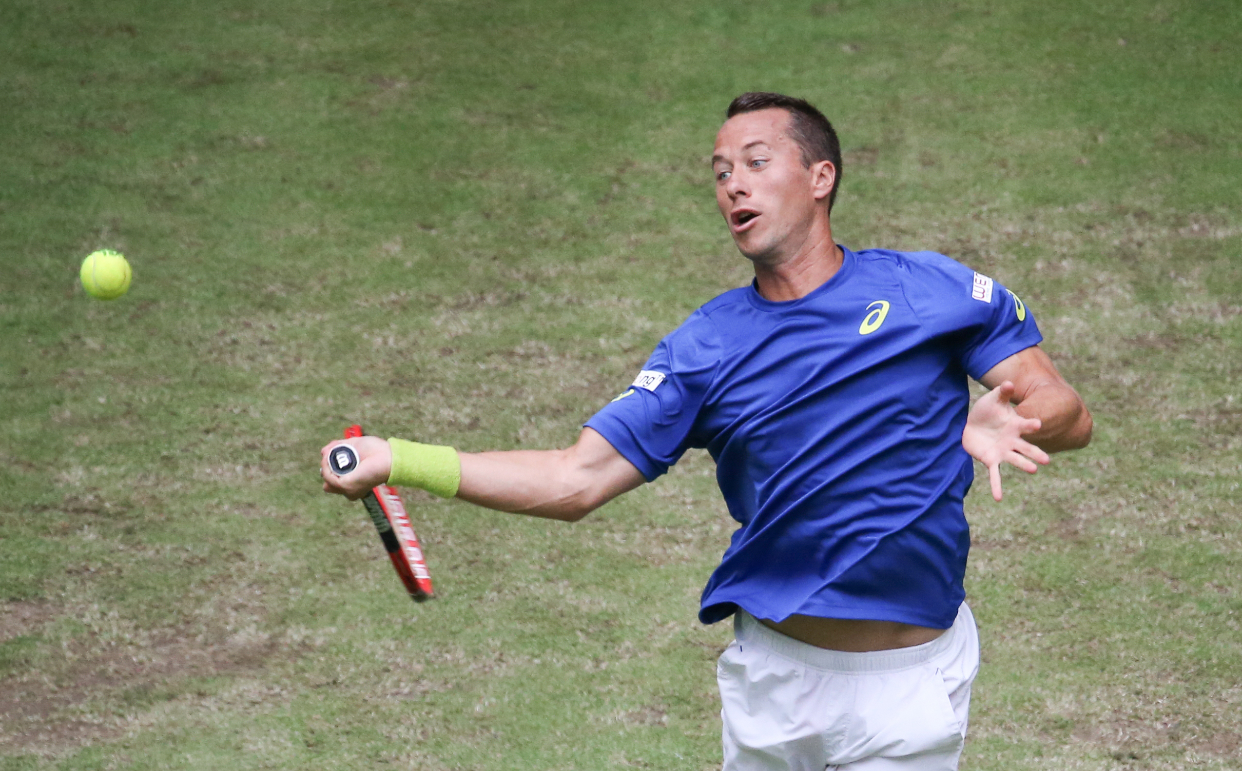 Germany's Phillip Kohlschreiber  returns  a ball to Spain's Marcel Granollers, at the Gerry Weber Open ATP tennis tournament in Halle, Germany,  Wednesday June 15, 2016. ( Friso Gentsch/dpa via AP)