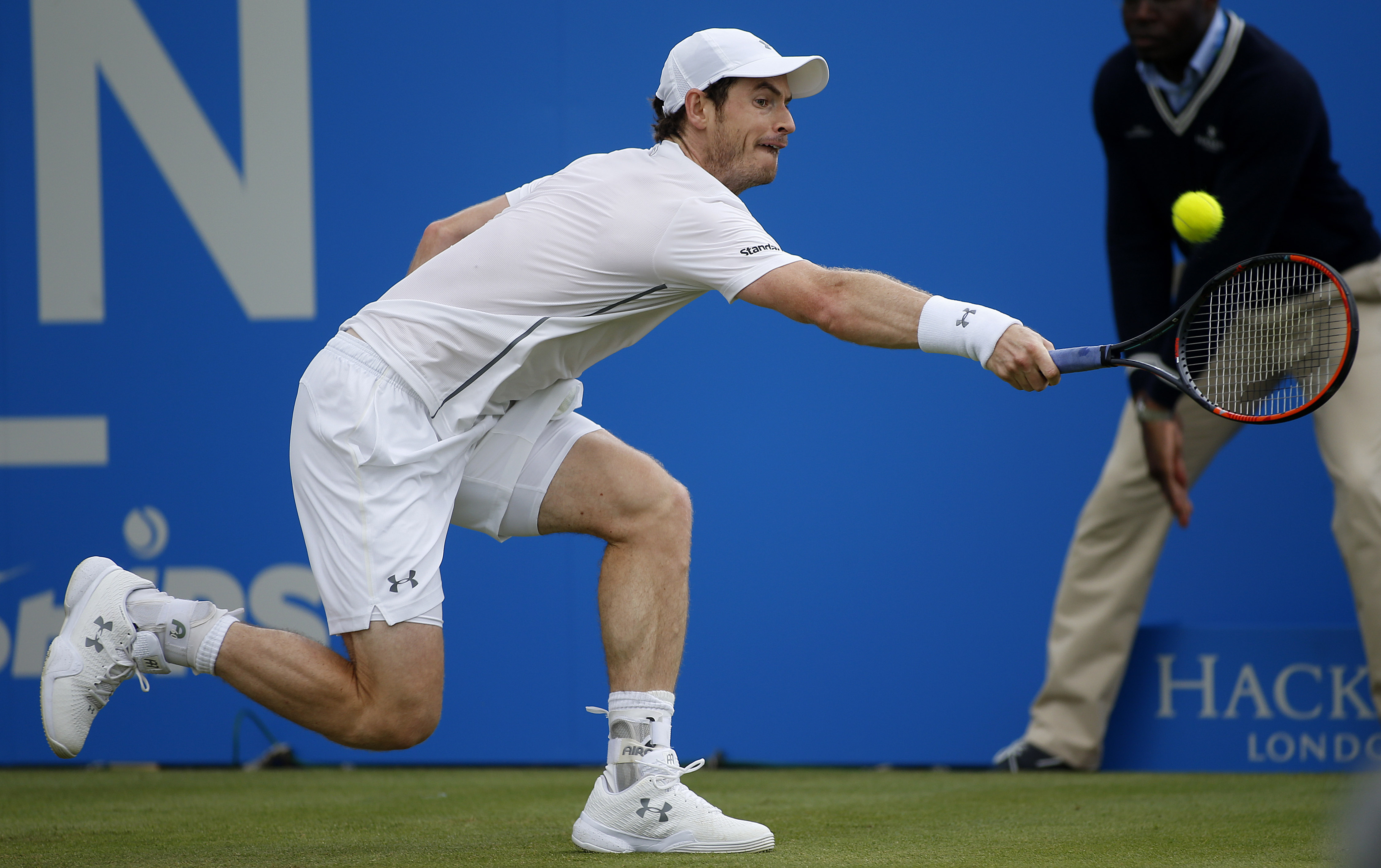 Britain's Andy Murray returns the ball to his compatriot Aljaz Bedene during day four of the 2016 tennis Championships at The Queen's Club, London, Thursday, June 16, 2016. (Steve Paston/PA via AP) UNITED KINGDOM OUT  NO SALES NO ARCHIVE