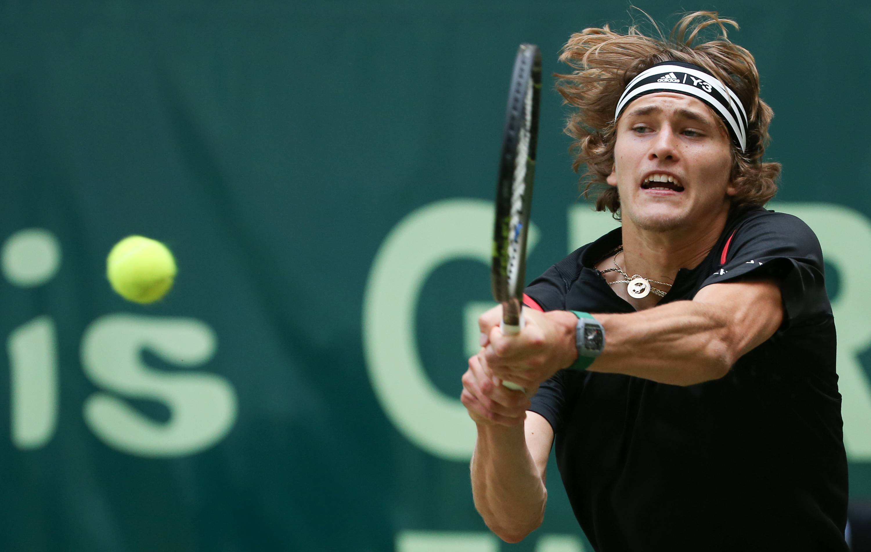 Germany's Alexander Zverev returns the ball to Germany's Florian Mayer, during the final match of the Gerry Weber Open ATP tennis tournament in Halle, western Germany, Sunday June 19, 2016.  (Friso Gentsch/dpa via AP)