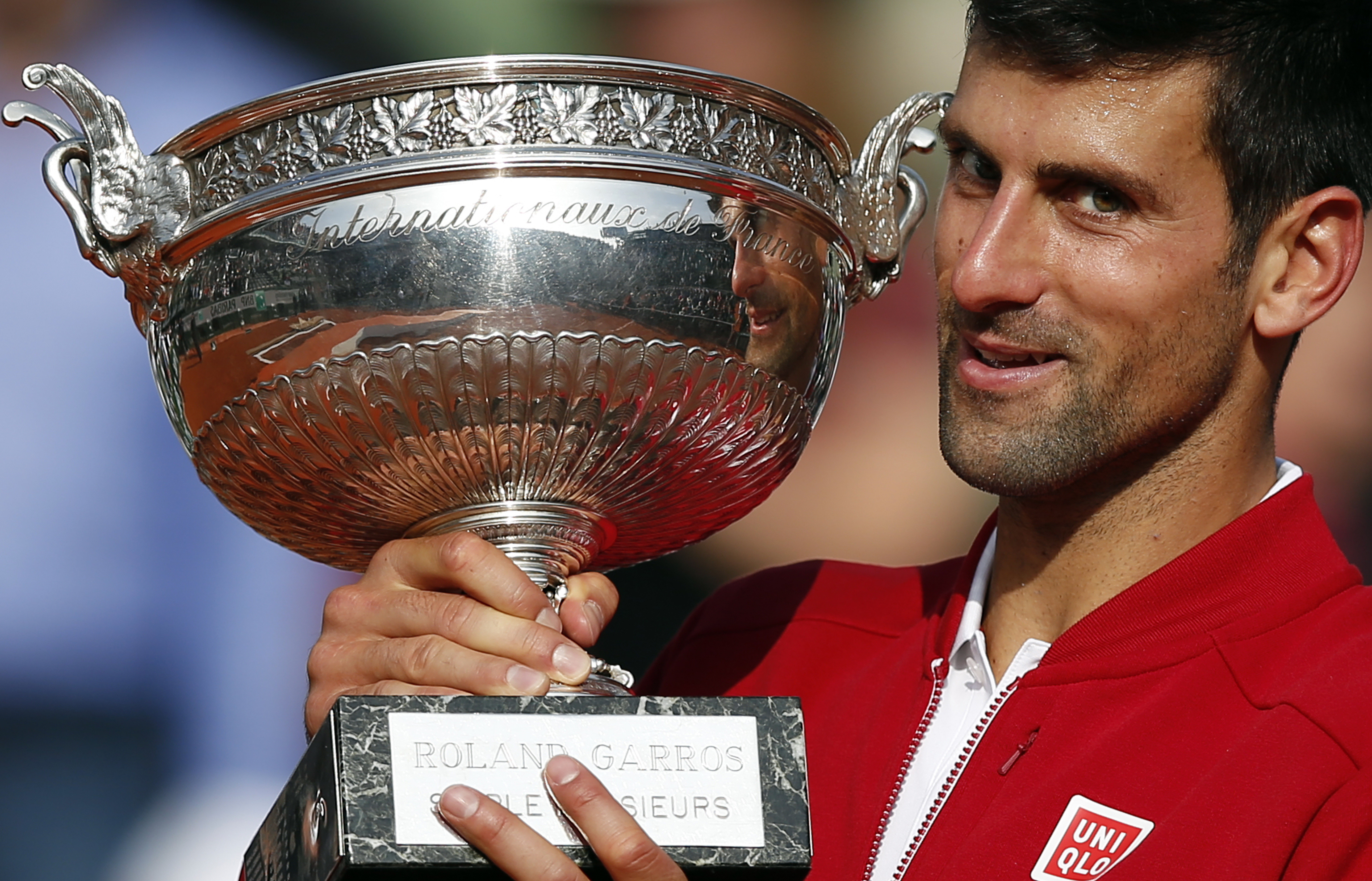 FILE - In this June 5, 2016, file photo, Serbia's Novak Djokovic holds the trophy after winning the final of the French Open tennis tournament against Britain's Andy Murray in four sets 3-6, 6-1, 6-2, 6-4, at the Roland Garros stadium in Paris, France. If