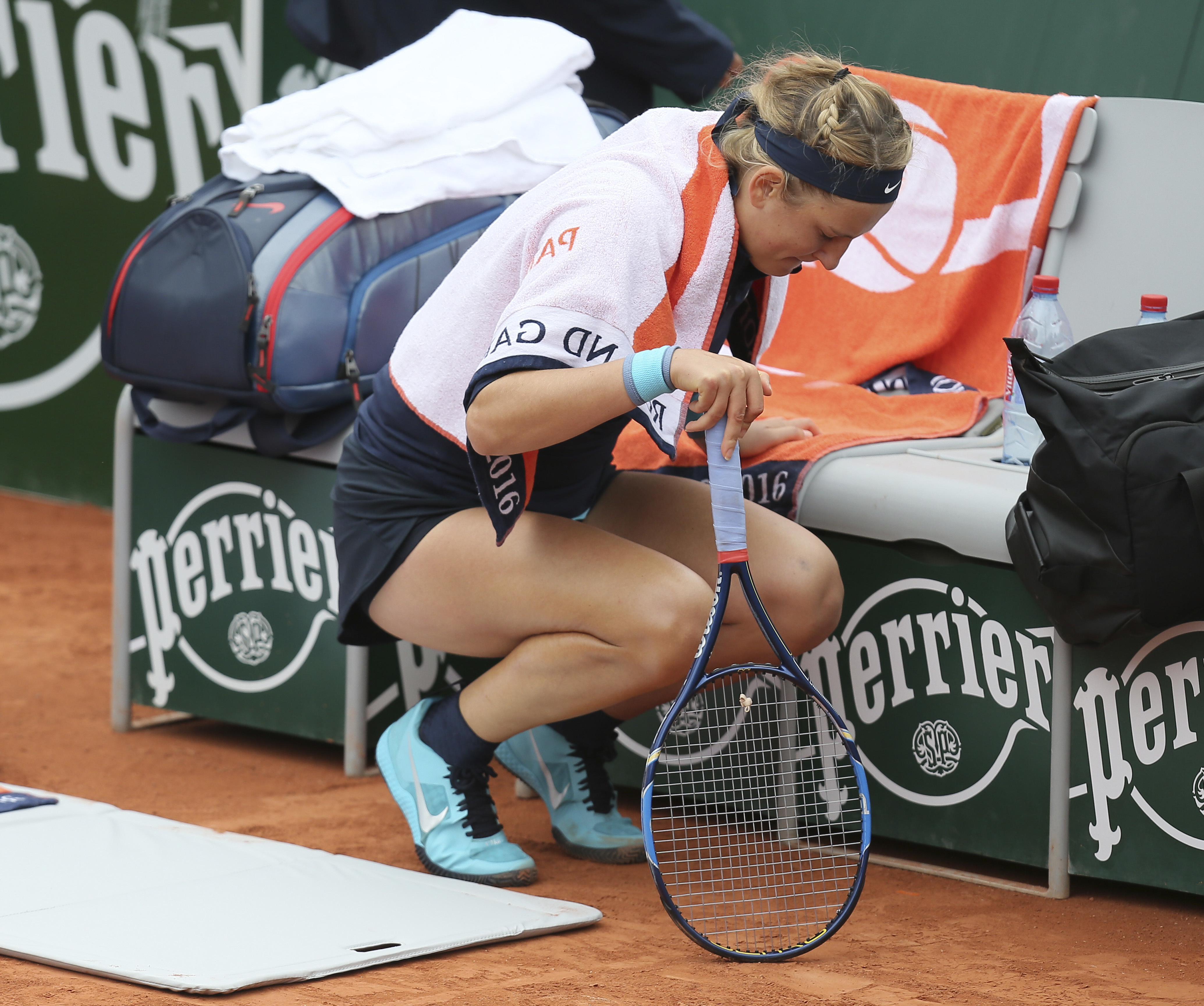FILE - This is a Tuesday, May 24, 2016 file photo of Victoria Azarenka of Belarus  after she was treated for an injured right knee during her first round match of the French Open tennis tournament against Italy's Karin Knapp at the Roland Garros stadium i