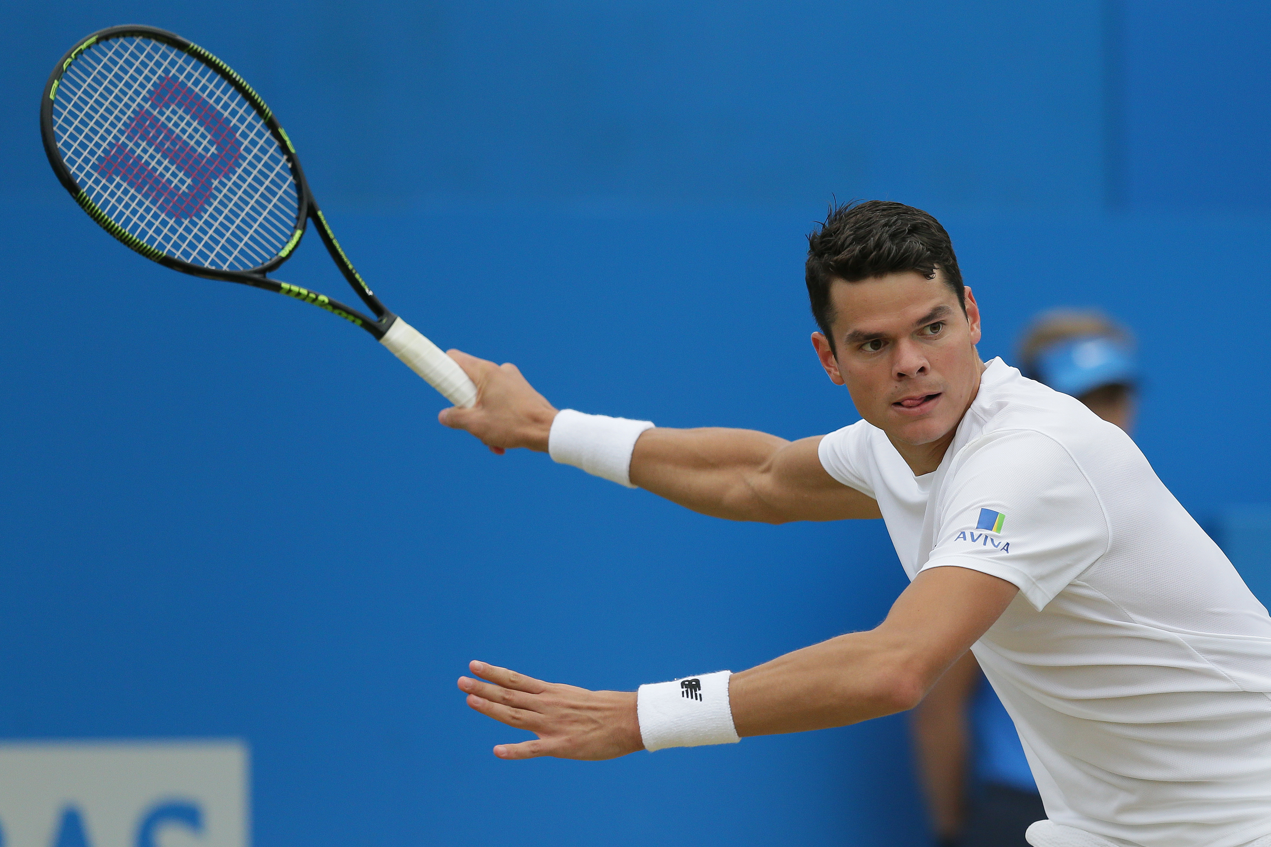 FILE - In this June 19, 2016 file photo, Canada's Milos Raonic plays a return to Britain's Andy Murray during their final tennis match at Queen's Championships London, England.  (AP Photo/Tim Ireland, file)