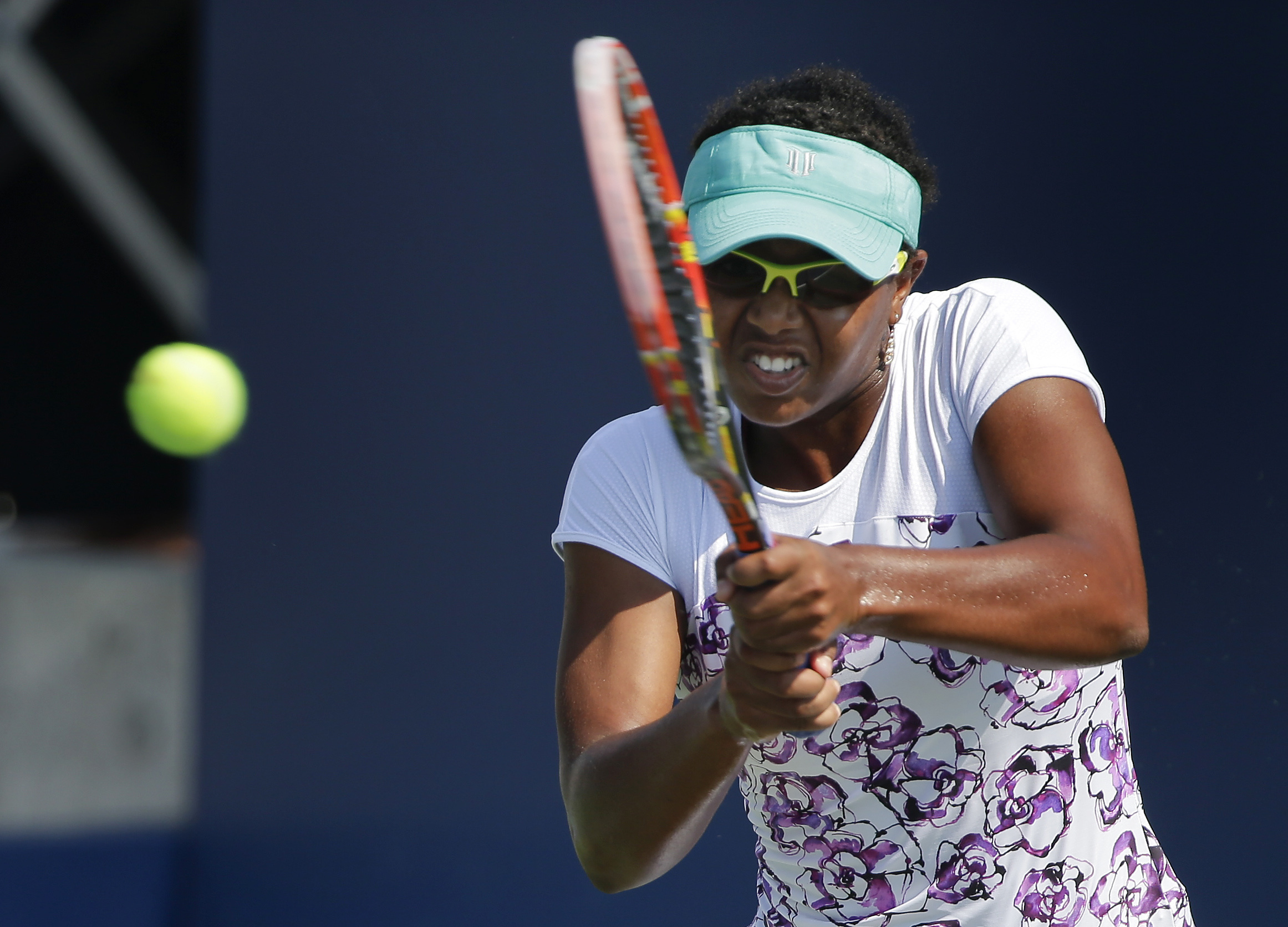 FILE - This is a Tuesday, Aug. 25, 2015  file photo of Vicky Duval, of the United States, returns a shot to Luksika Kumkhum, of Thailand, during the first set of a U.S. Open qualifying tennis match  in New York. Vicky Duval was back at Wimbledon on Monday
