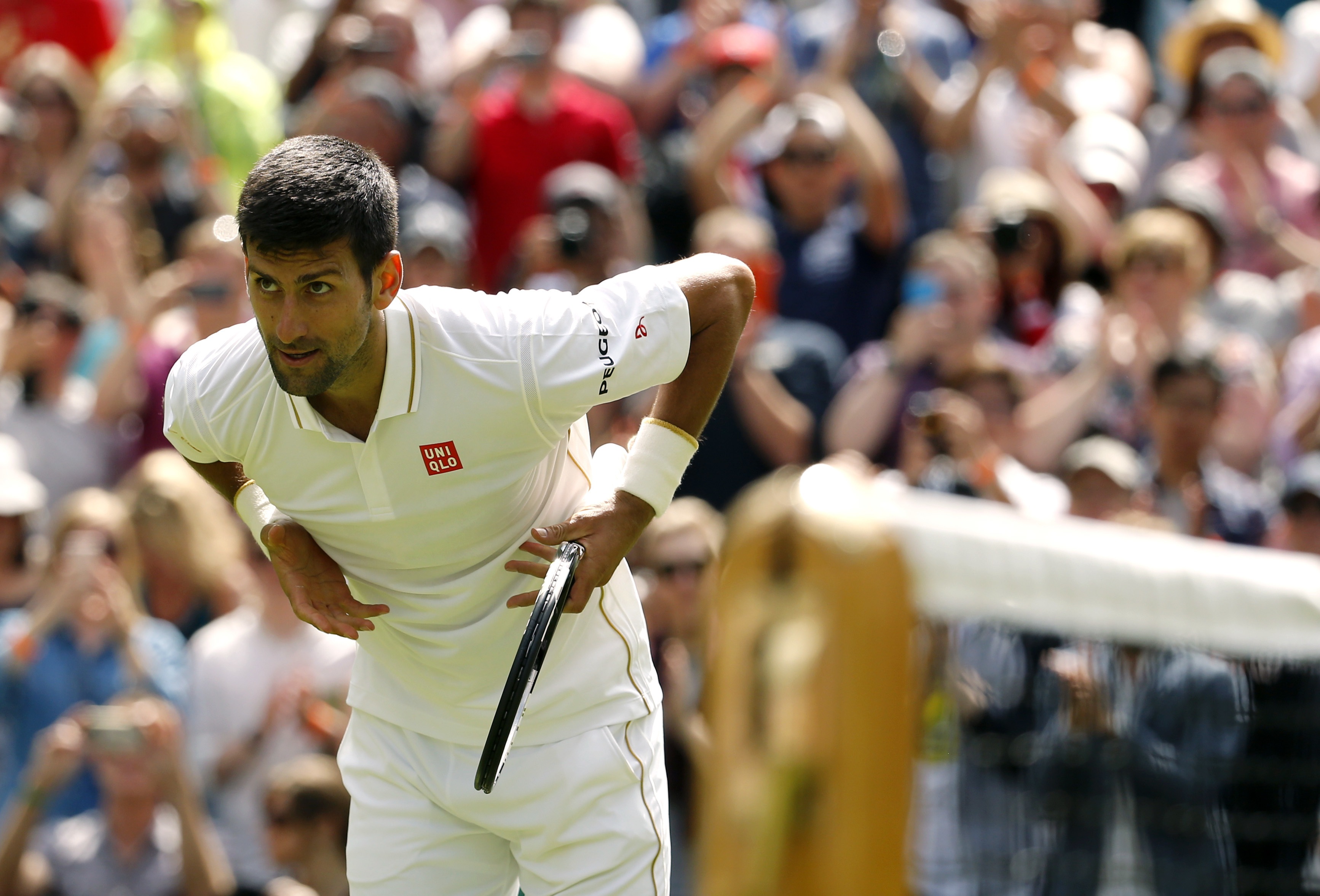 Novak Djokovic of Serbia celebrates after beating James Ward of Britain during their men's singles match on day one of the Wimbledon Tennis Championships in London, Monday, June 27, 2016. (AP Photo/Alastair Grant)