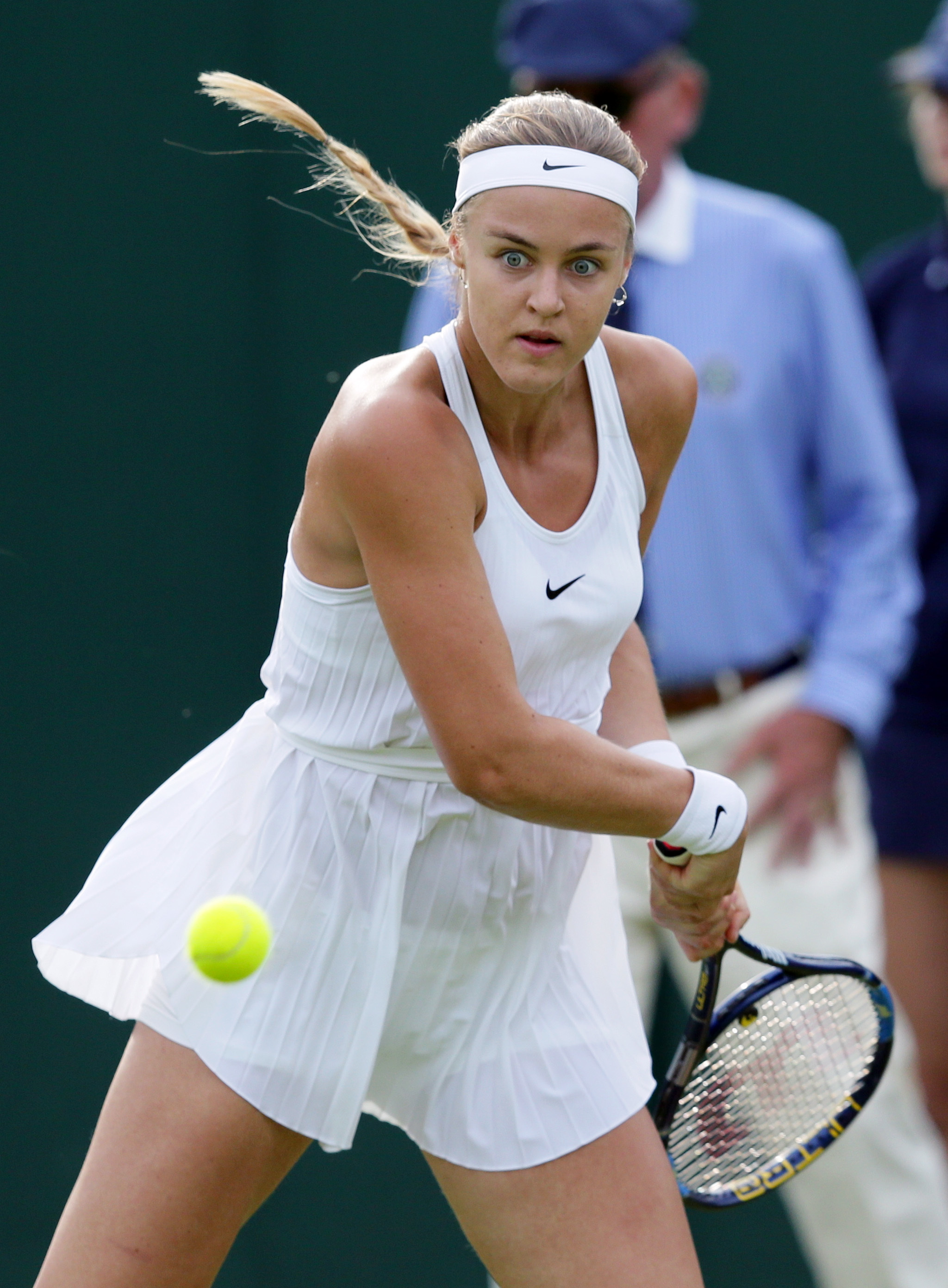 Anna Schmiedlova of Slovakia returns to Simona Halep of Romania during their women's singles match on day one of the Wimbledon Tennis Championships in London, Monday, June 27, 2016. (AP Photo/Tim Ireland)