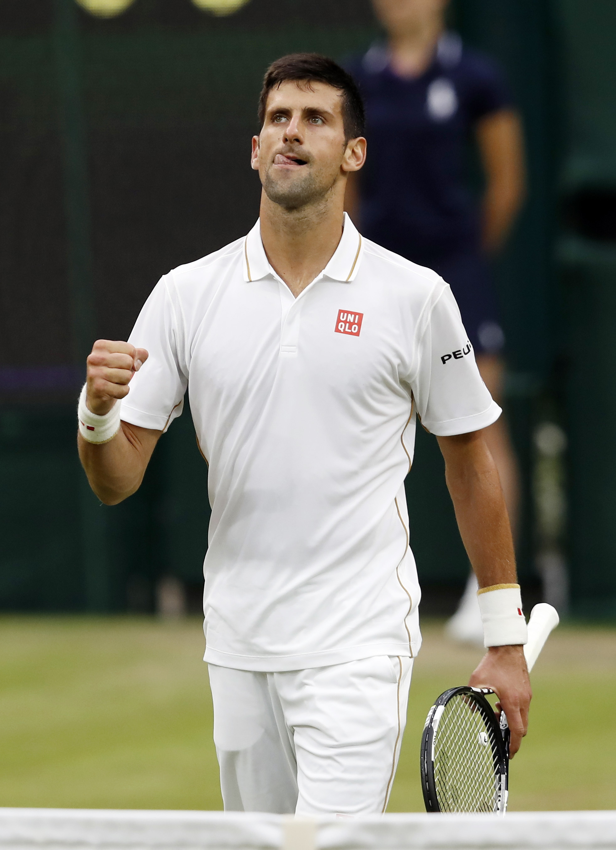 Novak Djokovic of Serbia celebrates after beating Adrian Mannarino of France in their men's singles match on day three of the Wimbledon Tennis Championships in London, Wednesday, June 29, 2016. (AP Photo/Ben Curtis)