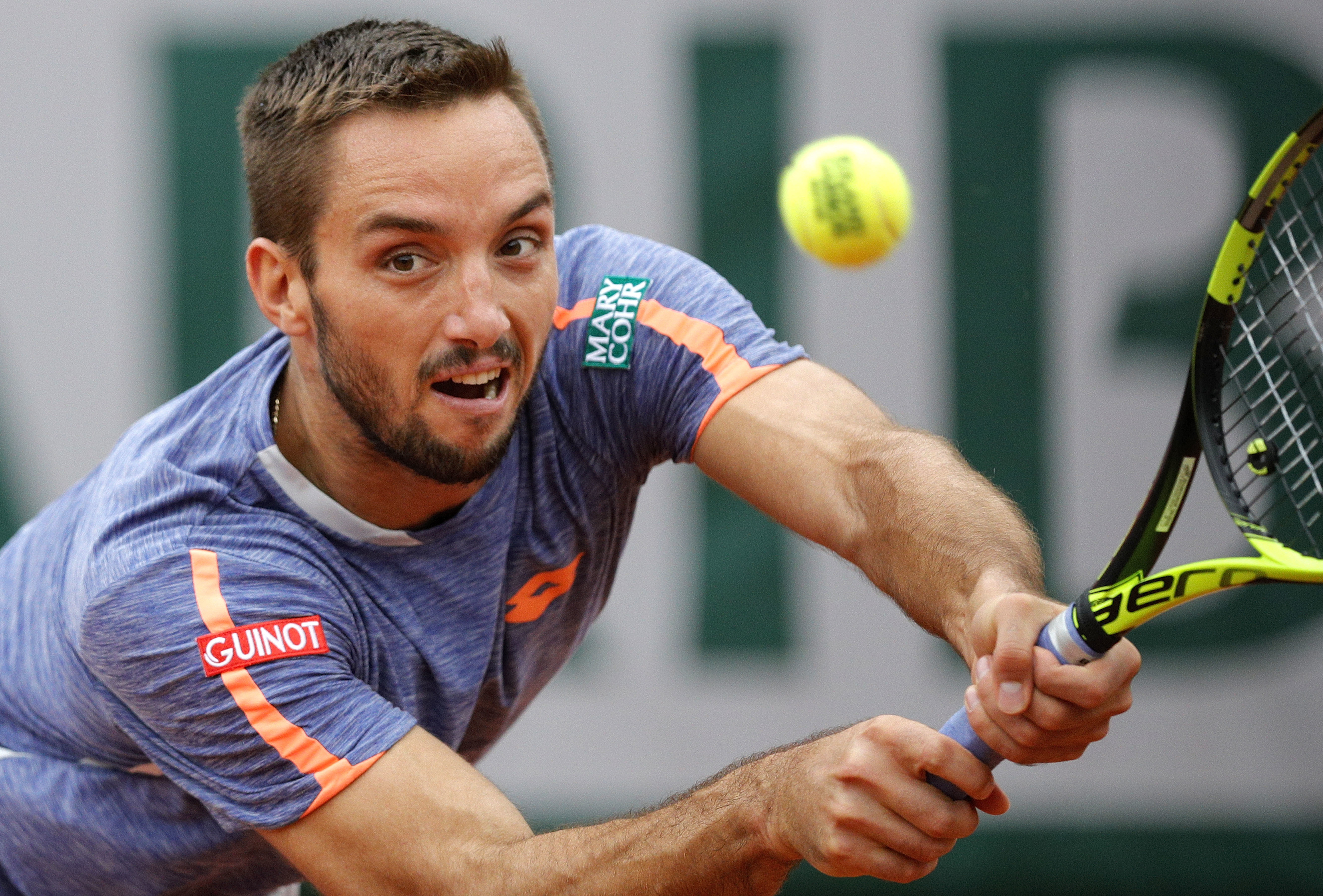 FILE - In this Sunday, May 29, 2016 file photo, Serbia's Viktor Troicki returns the ball to Switzerland's Stan Wawrinka during their fourth round match of the French Open tennis tournament at the Roland Garros stadium, in Paris. Viktor Troicki let the cha
