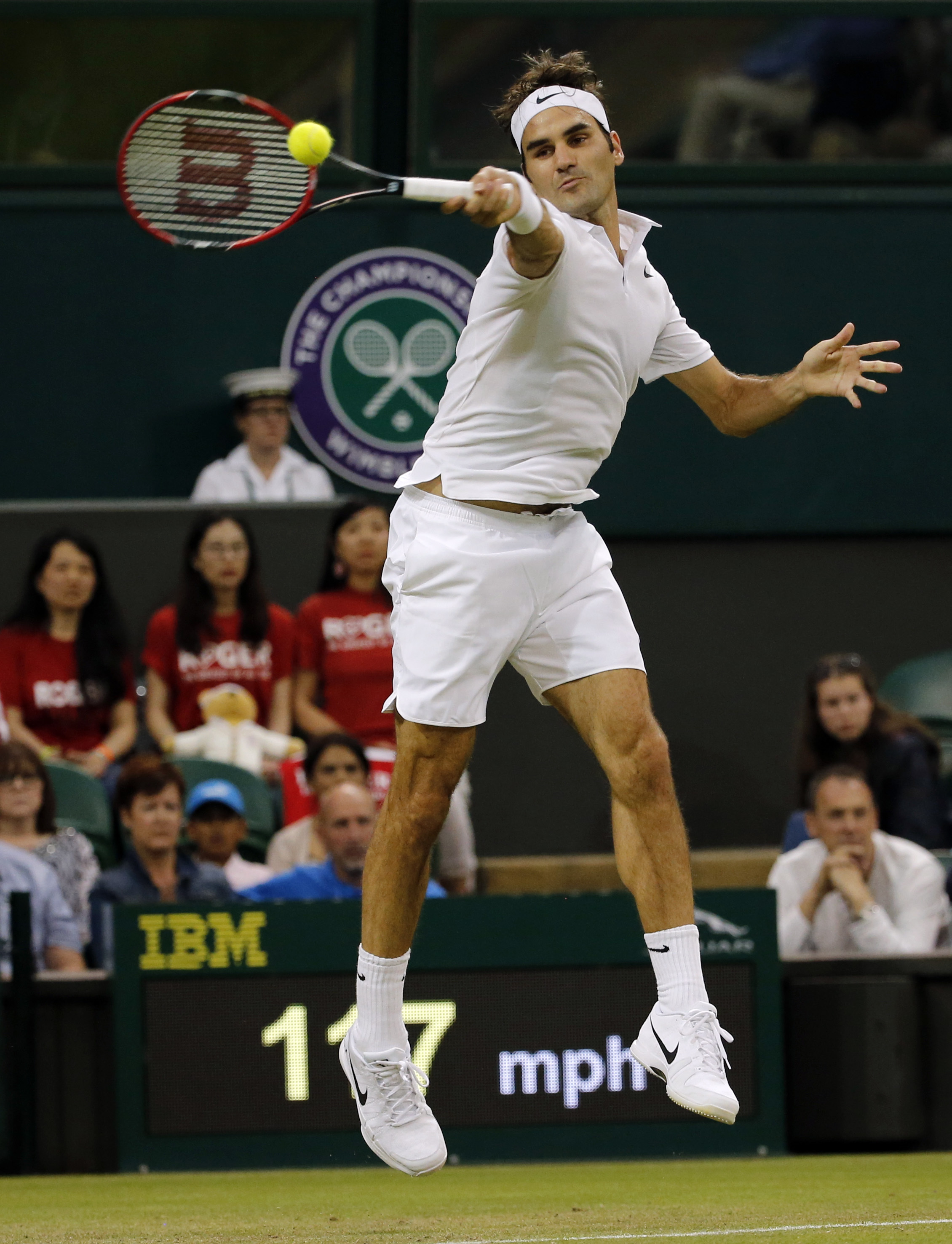Roger Federer of Switzerland returns to Daniel Evans of Britain during their men's singles match on day five of the Wimbledon Tennis Championships in London, Friday, July 1, 2016. (AP Photo/Ben Curtis)