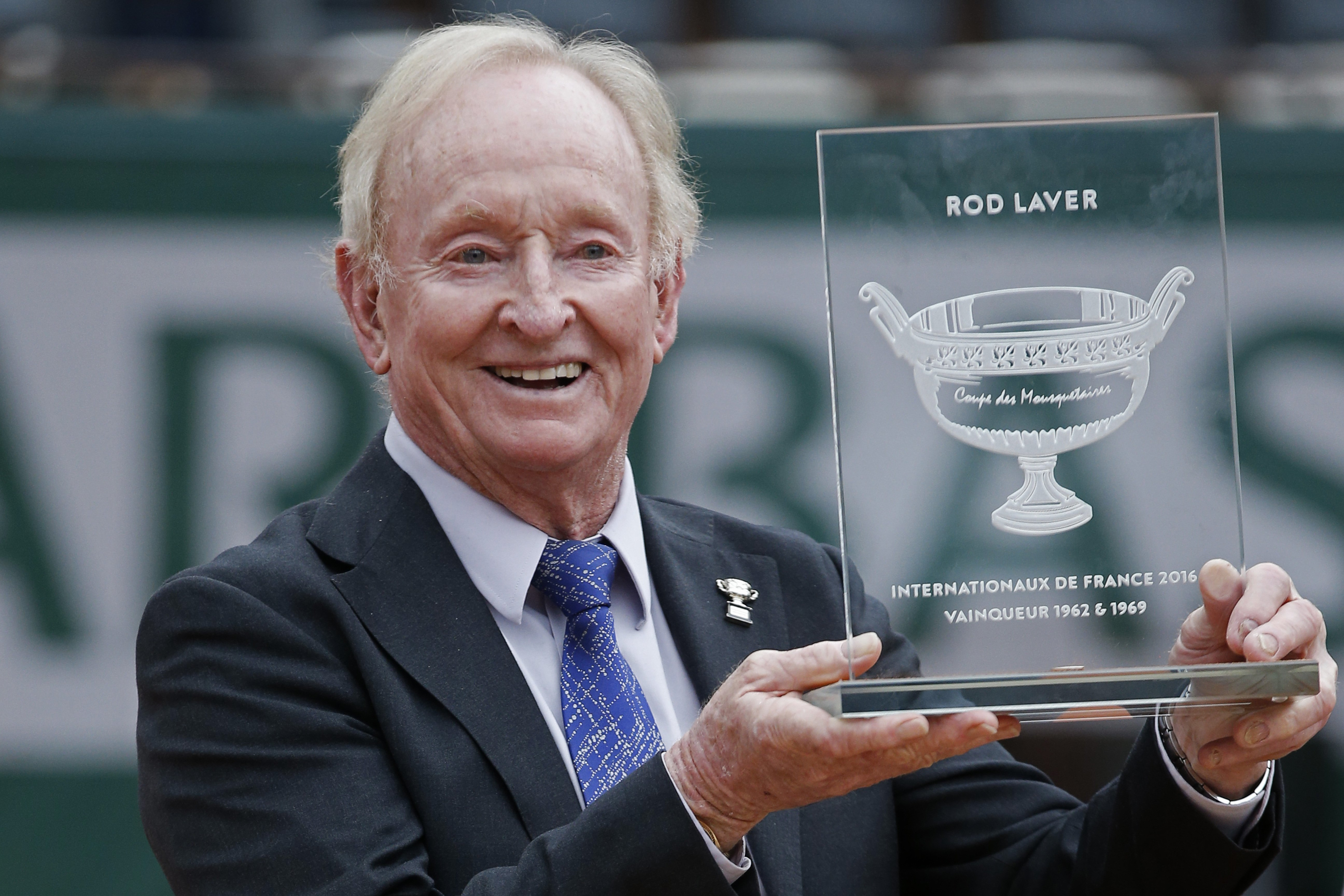 FILE - In this Friday, June 3, 2016 file photo former Australian tennis champion Rod Laver holds an award he received from the French tennis Federation during the French Open tennis tournament at the Roland Garros stadium in Paris, France. (AP Photo/Alast