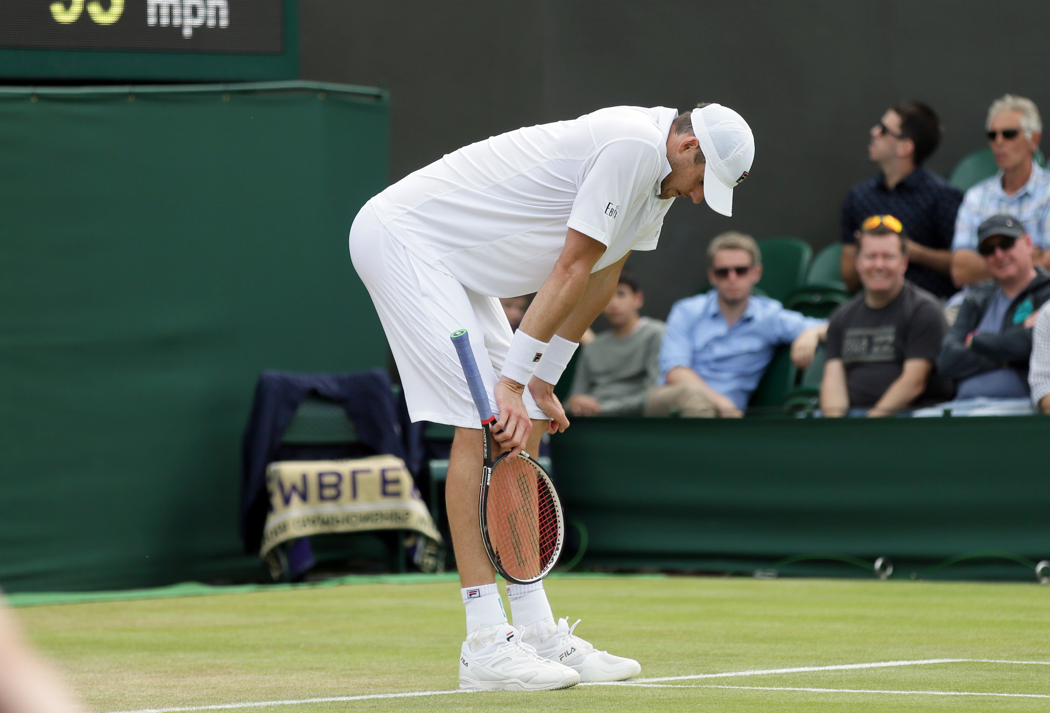 John Isner of the U.S reacts during his men's singles match against Jo-Wilfried Tsonga of France on day seven of the Wimbledon Tennis Championships in London, Sunday, July 3, 2016. (AP Photo/Tim Ireland)
