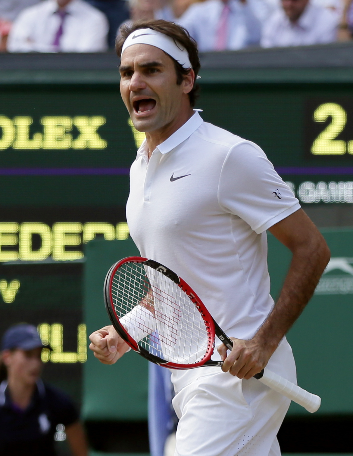 Roger Federer of Switzerland celebrates a point against Marin Cilic of Croatia during their men's singles match on day ten of the Wimbledon Tennis Championships in London, Wednesday, July 6, 2016. (AP Photo/Tim Ireland)
