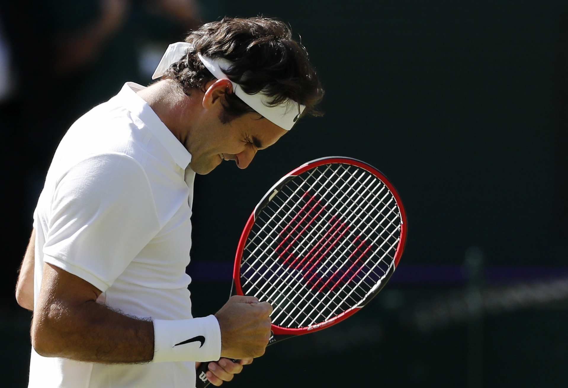 Roger Federer of Switzerland celebrates at match point after beating Marin Cilic of Croatia in their men's singles match on day ten of the Wimbledon Tennis Championships in London, Wednesday, July 6, 2016. (AP Photo/Ben Curtis)