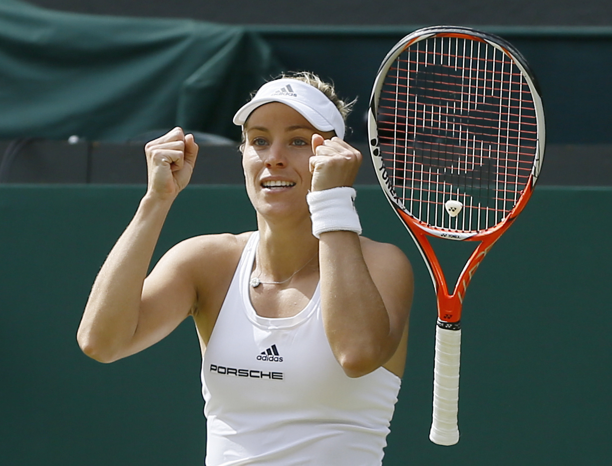 Angelique Kerber of Germany celebrates after beating Venus Williams of the U.S in their women's singles match on day eleven of the Wimbledon Tennis Championships in London,  Thursday, July 7, 2016. (AP Photo/Kirsty Wigglesworth)