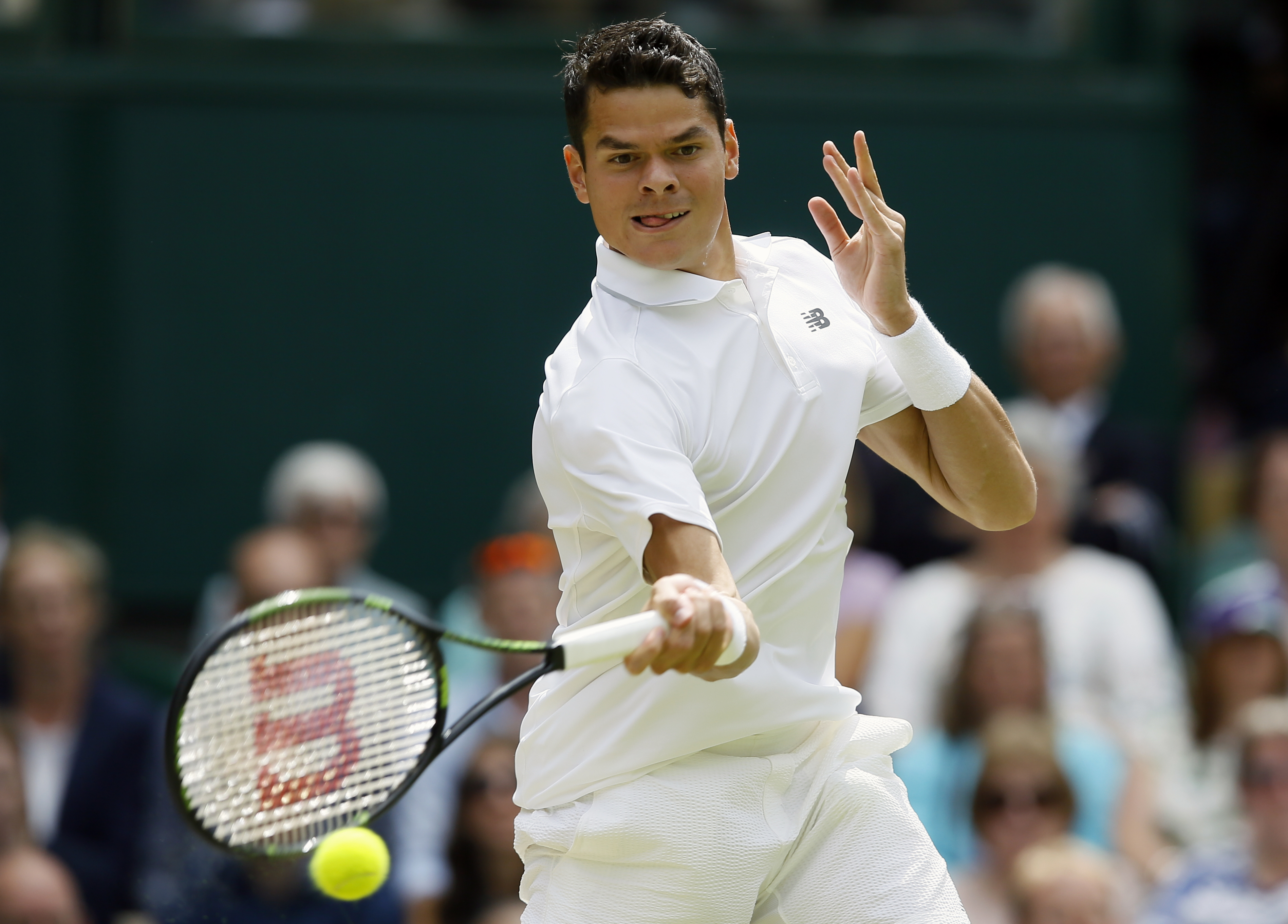Milos Raonic of Canada returns to Andy Murray of Britain during the men's singles final on the fourteenth day of the Wimbledon Tennis Championships in London, Sunday, July 10, 2016. (AP Photo/Kirsty Wigglesworth)