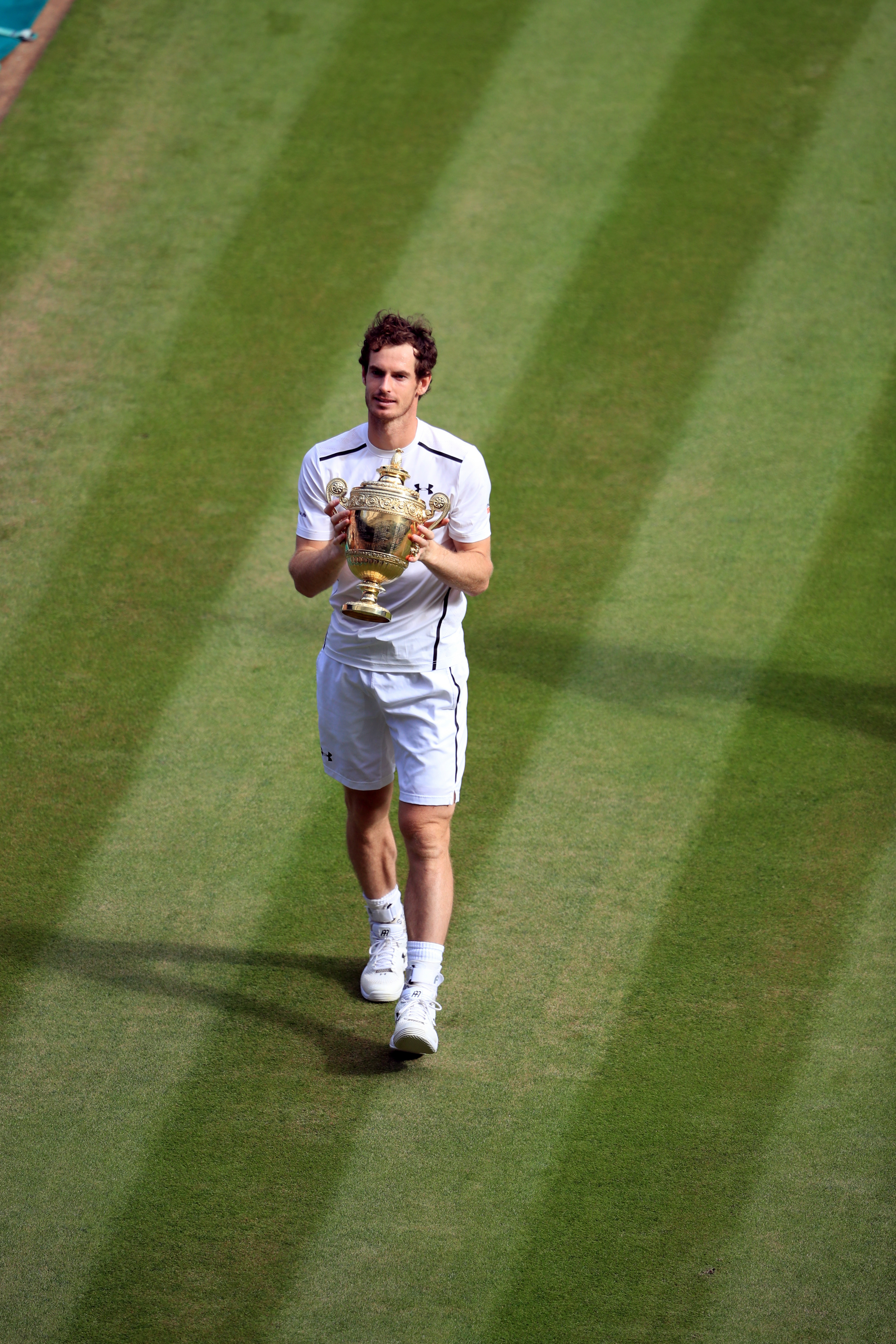 Andy Murray of Britain holds his trophy after beating Milos Raonic of Canada in the men's singles final on day fourteen of the Wimbledon Tennis Championships in London, Sunday, July 10, 2016. (John Walton/Pool Photo via AP)