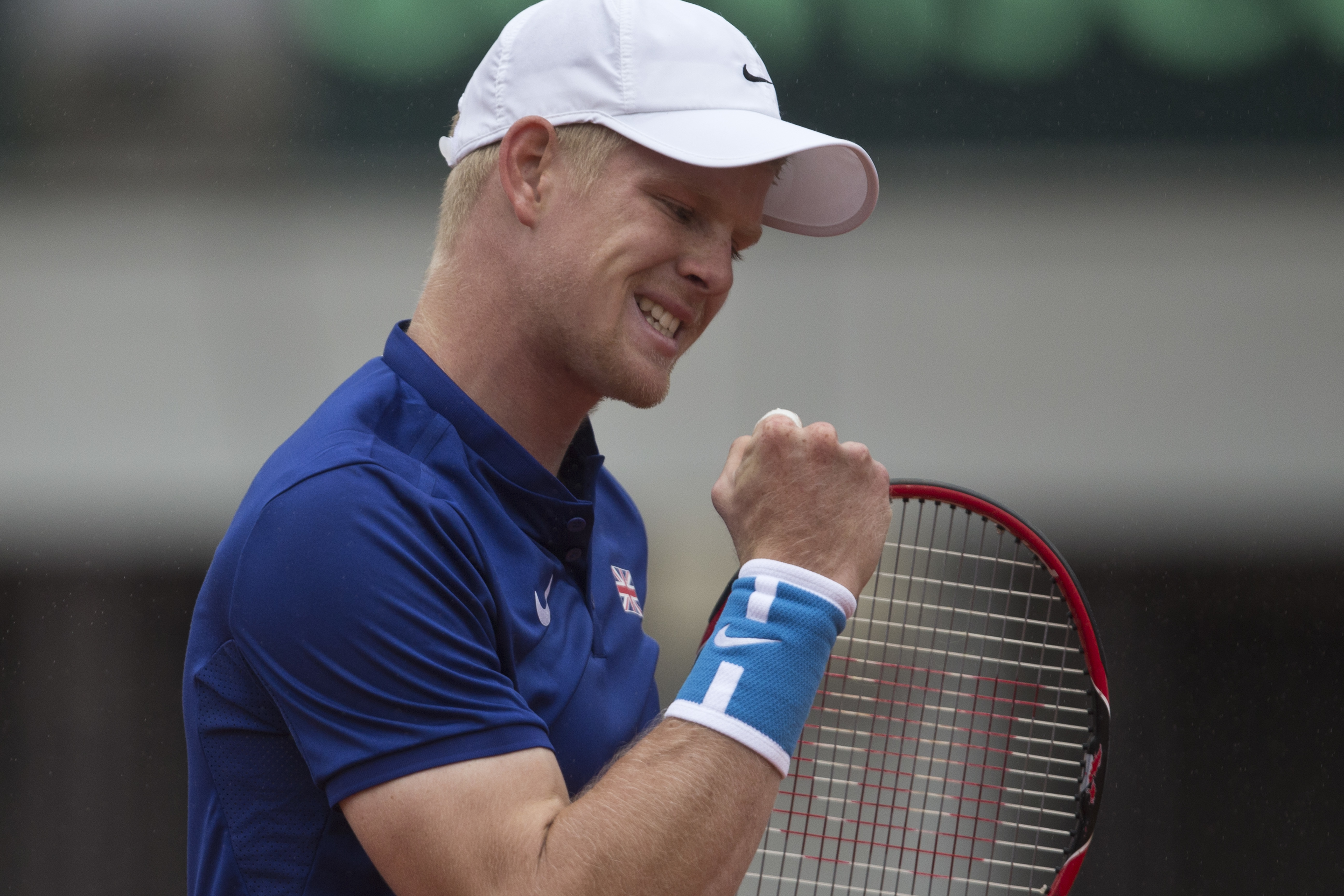 Britain's Kyle Edmund clenches his fist after having won a point against Serbia's Dusan Lajovic during their Davis Cup quarterfinal tennis match in Belgrade, Serbia, Sunday, July 17, 2016. (AP Photo/Marko Drobnjakovic)