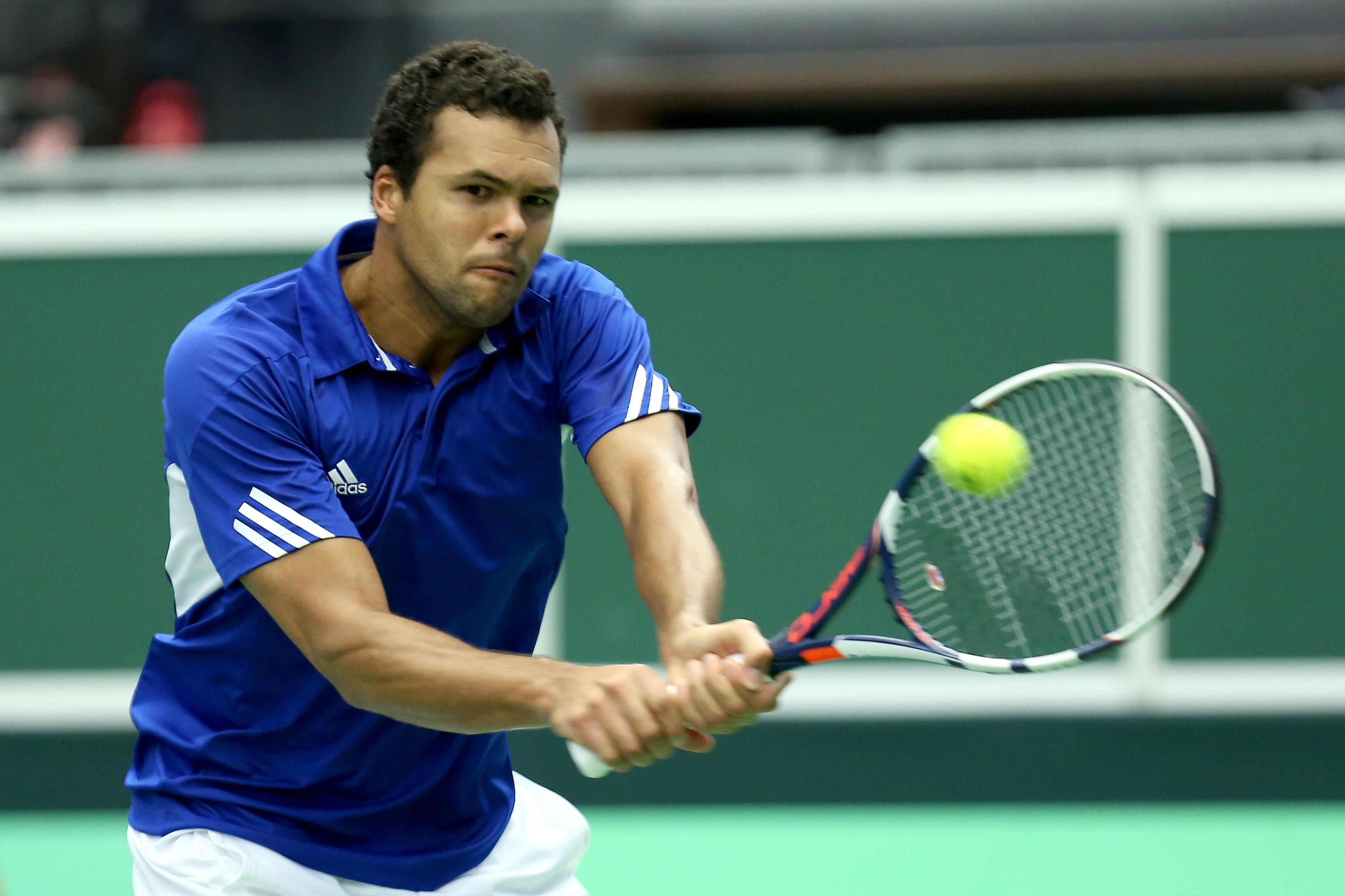 Jo-Wilfried Tsonga of France returns during his tennis Davis Cup quarterfinal match with Jiri Vesely of Czech Republic in Trinec, Czech Republic, Sunday, July 17, 2016.  (Petr Sznapka/CTK via AP)