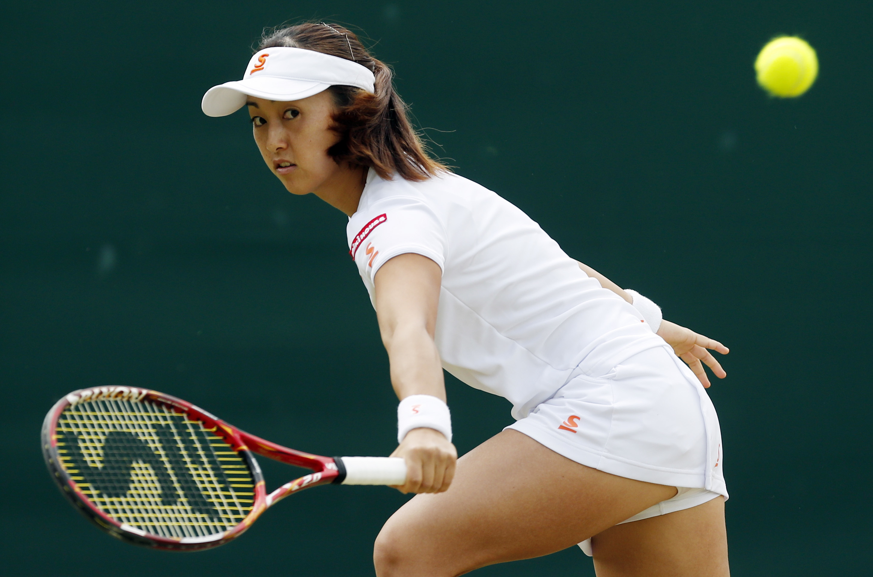 Misaki Doi of Japan warms up before her women's singles match against Angelique Kerber of Germany on day eight of the Wimbledon Tennis Championships in London, London, Monday, July, 4, 2016. (AP Photo/Ben Curtis)