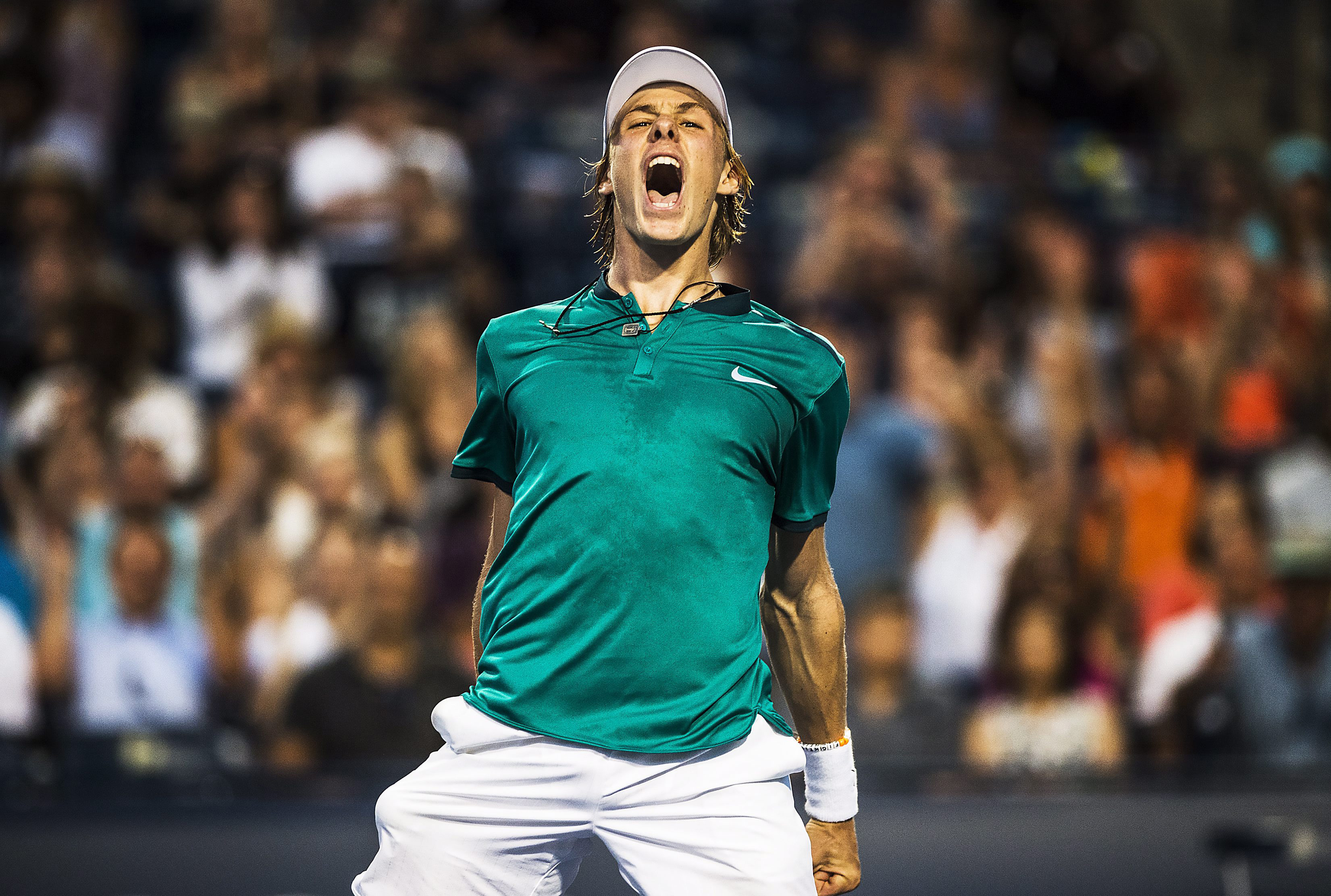 Denis Shapovalov, of Canada, celebrates his win against Nick Kyrgios, of Australia, during men's first round Rogers Cup tennis action in Toronto on Monday, July 25, 2016. (Aaron Vincent Elkaim/The Canadian Press via AP)