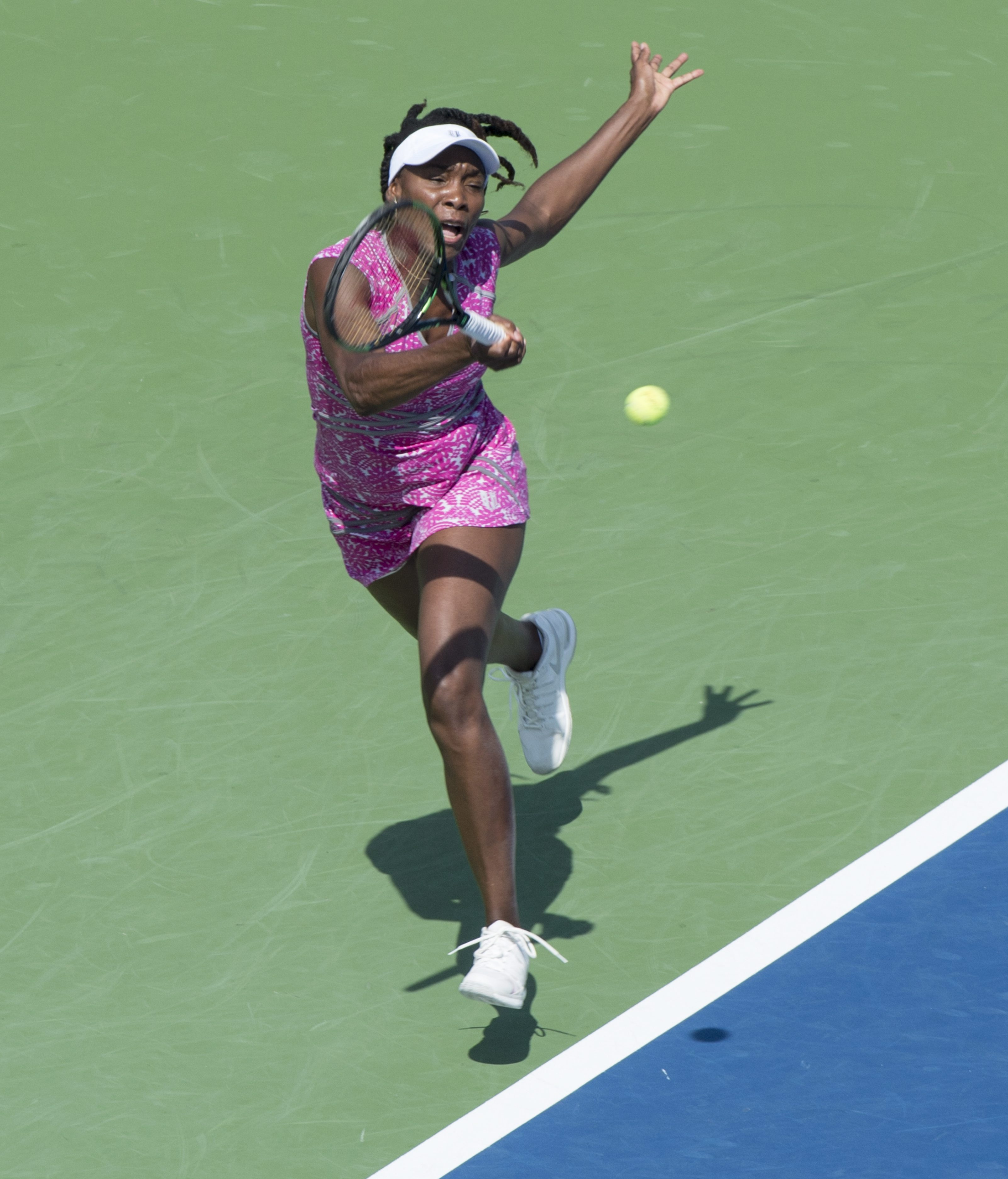 Venus Williams, of the United States, returns to Barbora Strycova, of the Czech Republic, during a second round match at the Rogers Cup tennis tournament Wednesday July 27, 2016 in Montreal. (Paul Chiasson/The Canadian Press via AP)