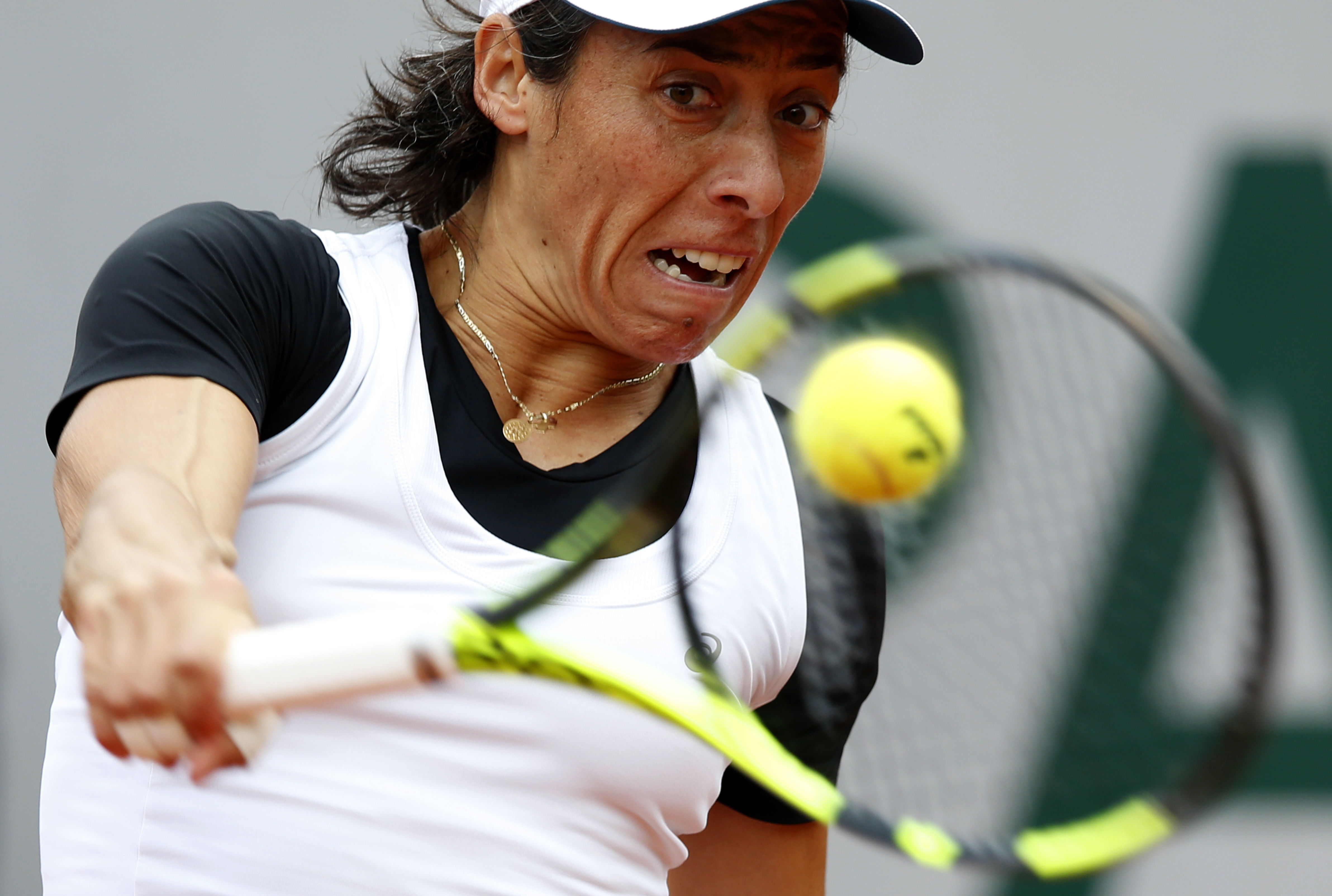 Italy's Francesca Schiavone returns the ball to France's Kristina Mladenovic during their first round match of the French Open tennis tournament at the Roland Garros stadium, Tuesday, May 24, 2016 in Paris.  (AP Photo/Alastair Grant)
