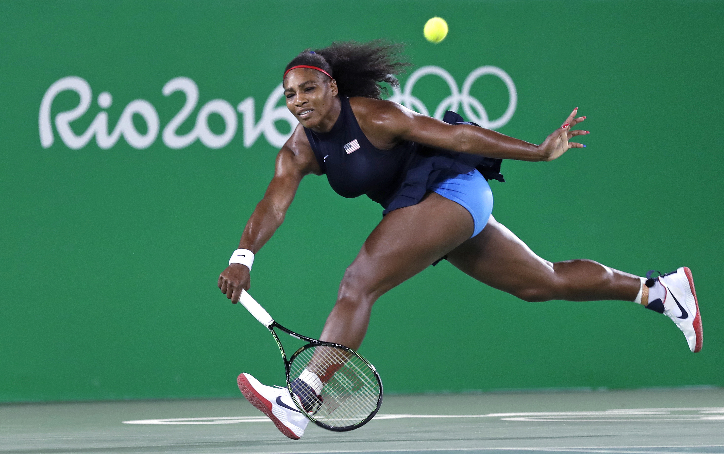 Serena Williams, of the United States, chases down a return during her loss to Elina Svitolina, of Ukraine, at the 2016 Summer Olympics in Rio de Janeiro, Brazil, Tuesday, Aug. 9, 2016. (AP Photo/Charles Krupa)
