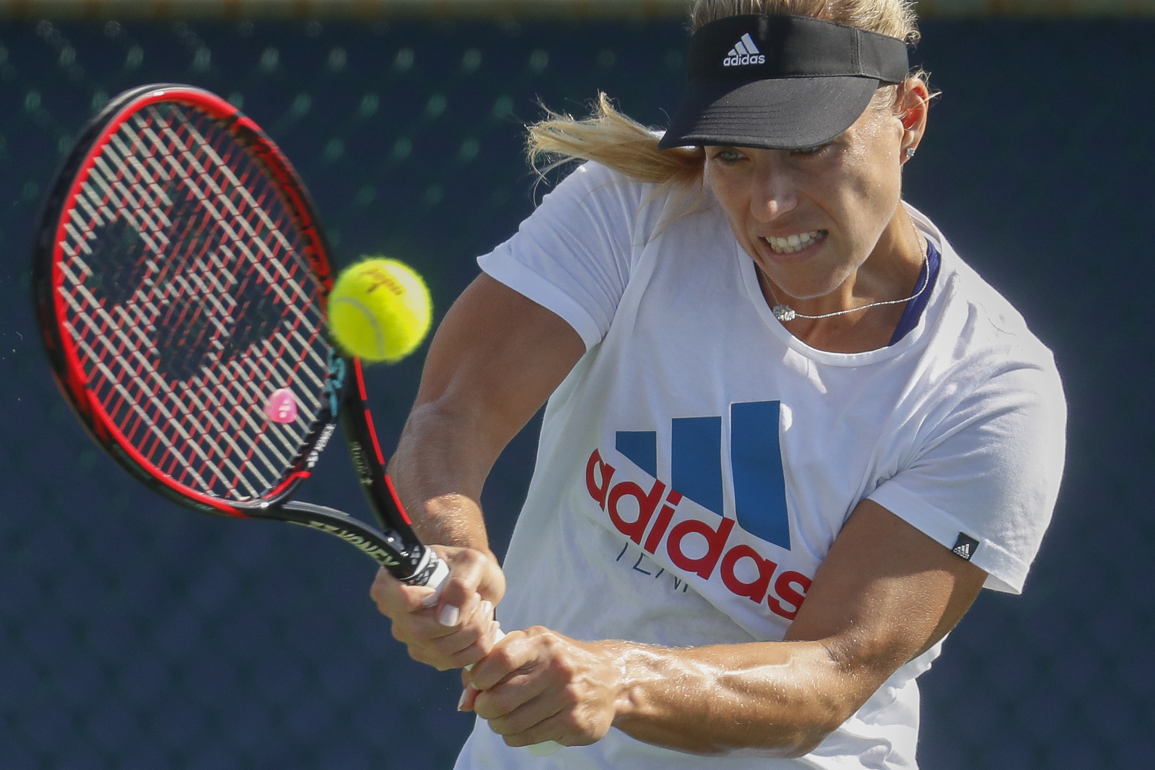 Angelique Kerber, of Germany, practices on the fourth day of the Western & Southern Open tennis tournament, Tuesday, Aug. 16, 2016, in Mason, Ohio. (AP Photo/John Minchillo)