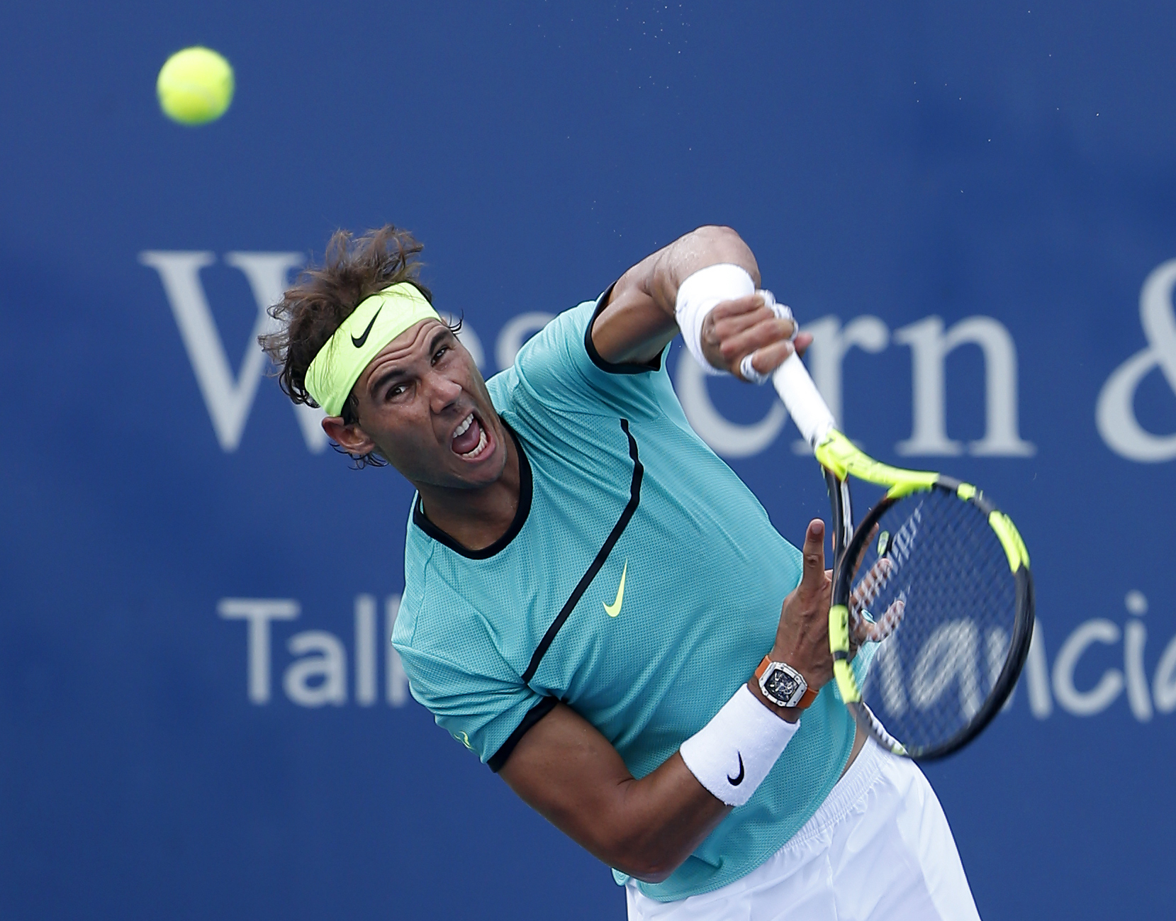 Rafael Nadal, from Spain, serves during a match against Borna Coric, from Croatia, at the Western & Southern Open tennis tournament, Thursday, Aug. 18, 2016, in Mason, Ohio. (AP Photo/Frank Victores)