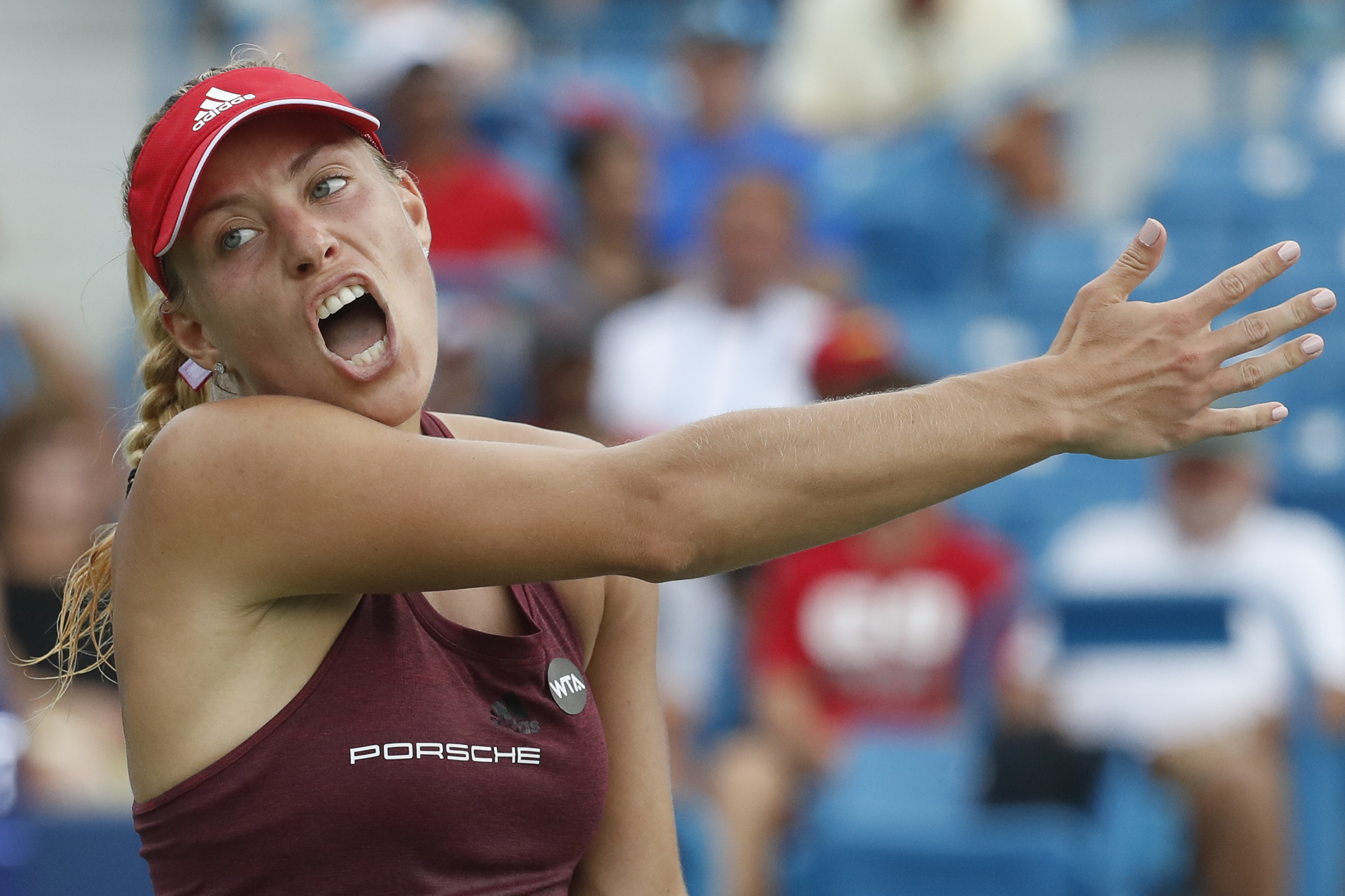 Angelique Kerber, of Germany, reacts during her match against Simona Halep, of Romania, during the semifinals of the Western & Southern Open tennis tournament, Saturday, Aug. 20, 2016, in Mason, Ohio. (AP Photo/John Minchillo)