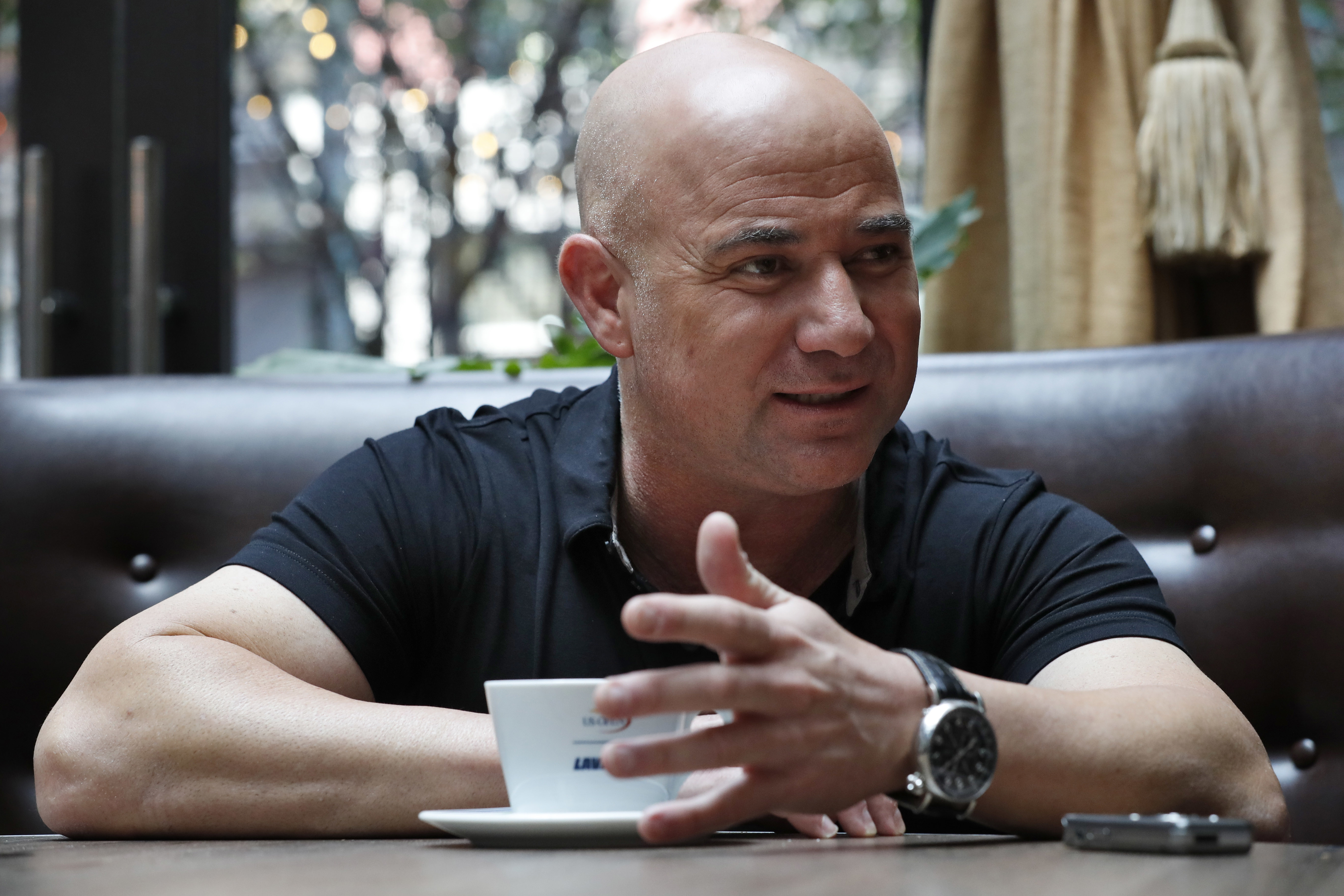 Andre Agassi speaks during an interview with The Associated Press, Tuesday, Aug. 30, 2016, in New York. It's been ten years since Agassi played the last match of his career at the 2006 US Open. (AP Photo/Mary Altaffer)