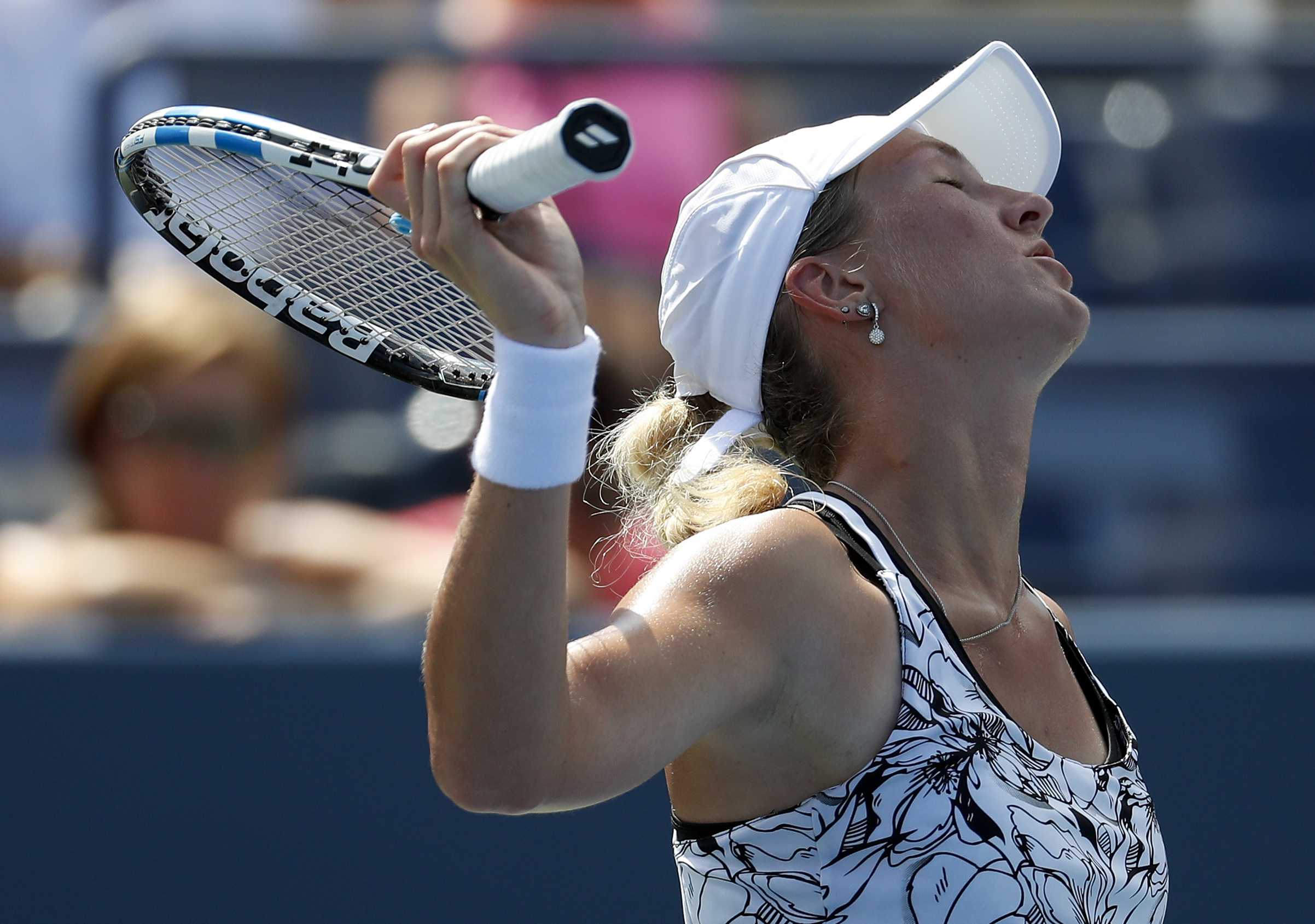 Denisa Allertova, of the Czech Republic, reacts after a point to Ana Ivanovic, of Serbia, during the first round of the U.S. Open tennis tournament, Tuesday, Aug. 30, 2016, in New York. (AP Photo/Alex Brandon)