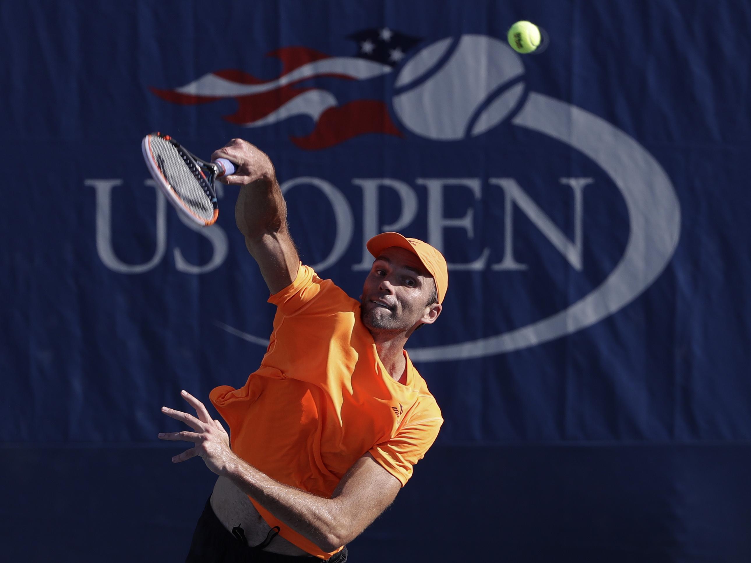 Ivo Karlovic, of Croatia, serves to Yen-Hsun Lu, of Taipei, during the first round of the U.S. Open tennis tournament, Tuesday, Aug. 30, 2016, in New York. (AP Photo/Seth Wenig)