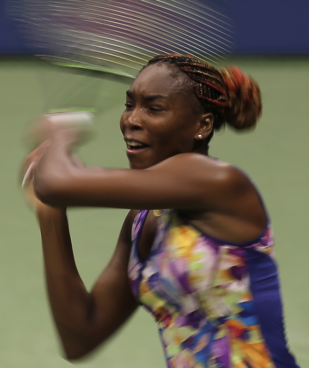 Venus Williams returns a shot to Julia Goerges, of Germany, during the second round of the U.S. Open tennis tournament, Thursday, Sept. 1, 2016, in New York. (AP Photo/Andres Kudacki)