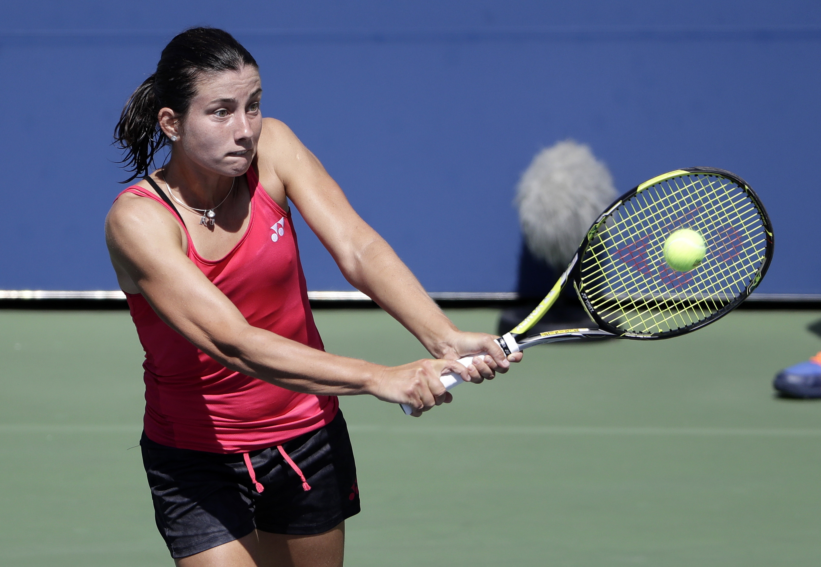 Anastasija Sevastova, of Latvia, returns a shot to Kateryna Bondarenko, of Ukraine, during the third round of the U.S. Open tennis tournament, Friday, Sept. 2, 2016, in New York. (AP Photo/Seth Wenig)