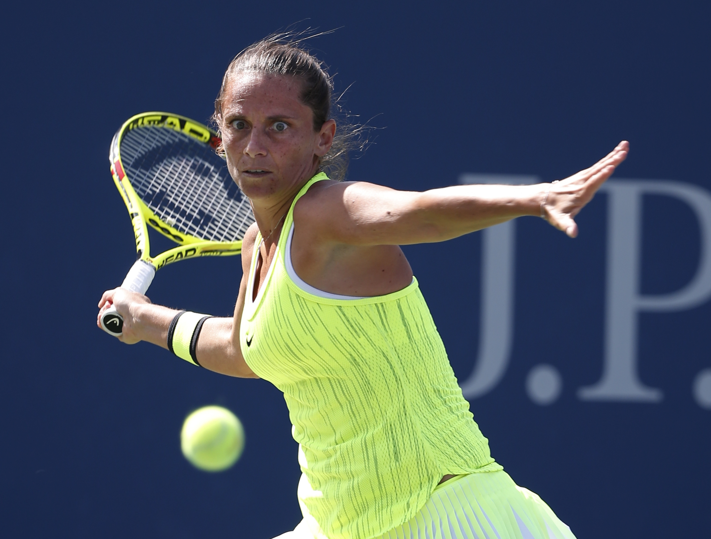 Roberta Vinci, of Italy, returns a shot to Lesia Tsurenko, of Ukraine, during the fourth round of the U.S. Open tennis tournament, Sunday, Sept. 4, 2016, in New York. (AP Photo/Kathy Willens)