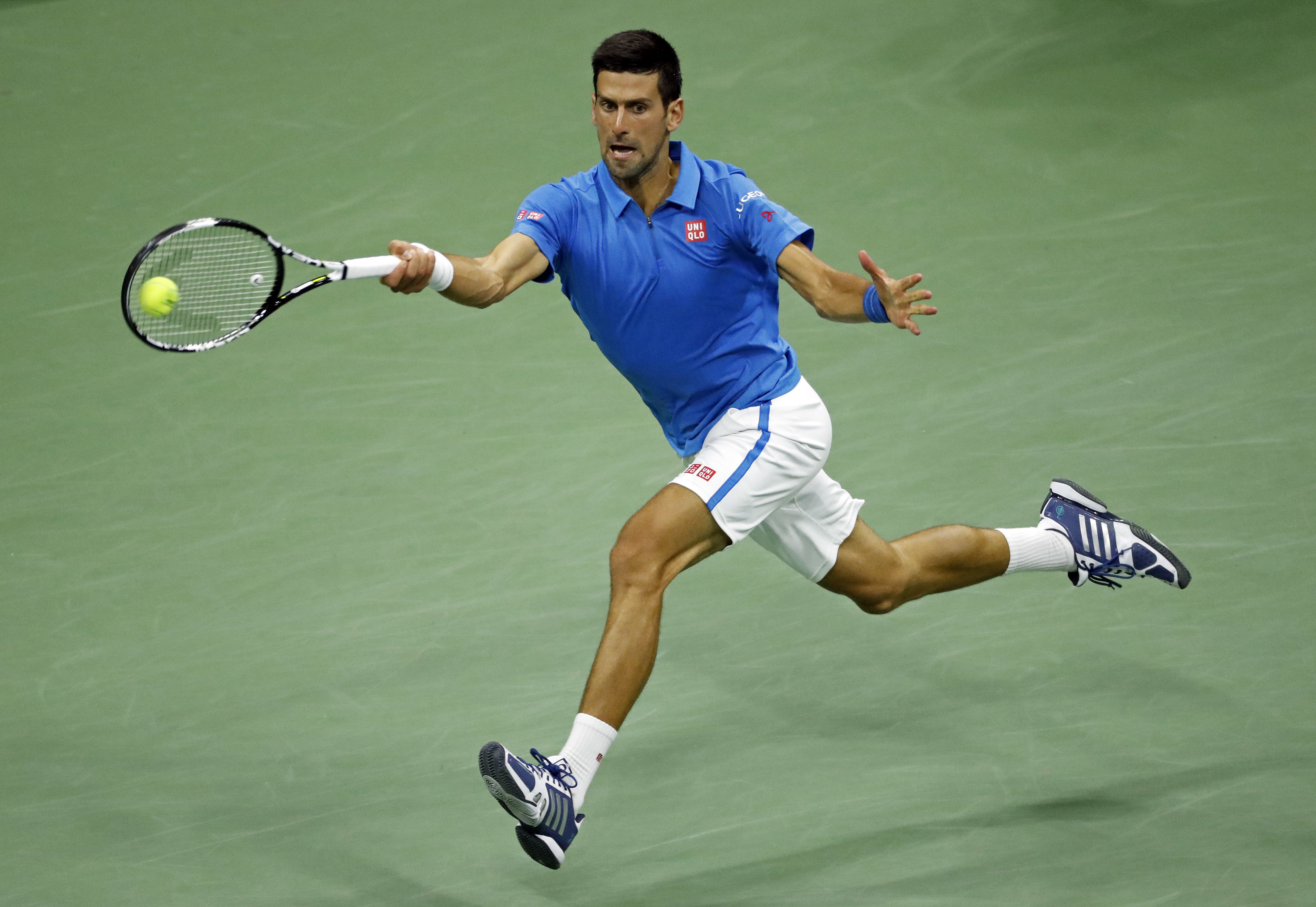 Novak Djokovic, of Serbia, hits a return shot to Kyle Edmund, of Britain, during the fourth round of the U.S. Open tennis tournament, Sunday, Sept. 4, 2016, in New York. (AP Photo/Adam Hunger)
