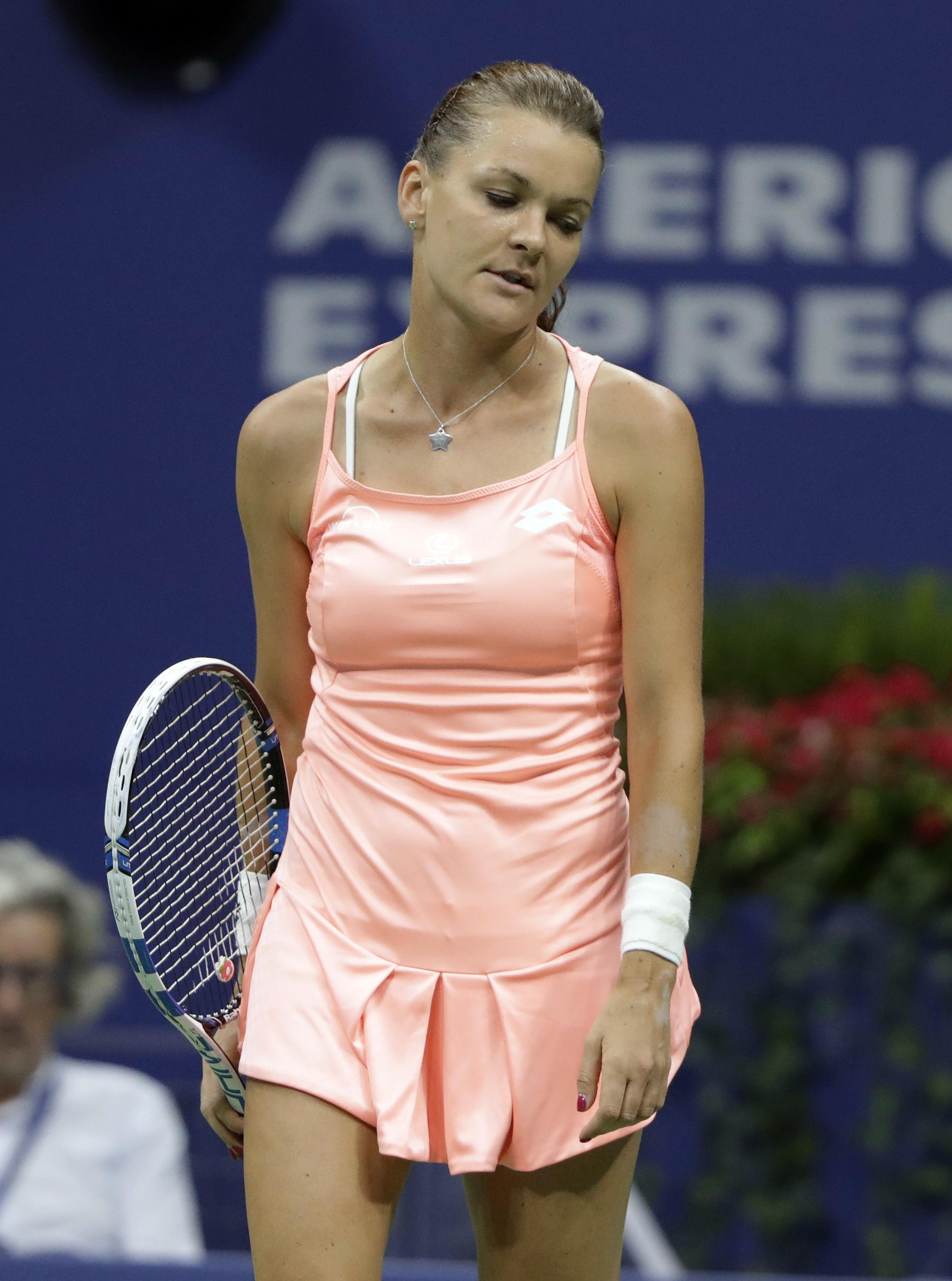 Agnieszka Radwanska, of Poland, reacts after missing a shot against Ana Konjuh, of Croatia, during the U.S. Open tennis tournament, Monday, Sept. 5, 2016, in New York. (AP Photo/Darron Cummings)