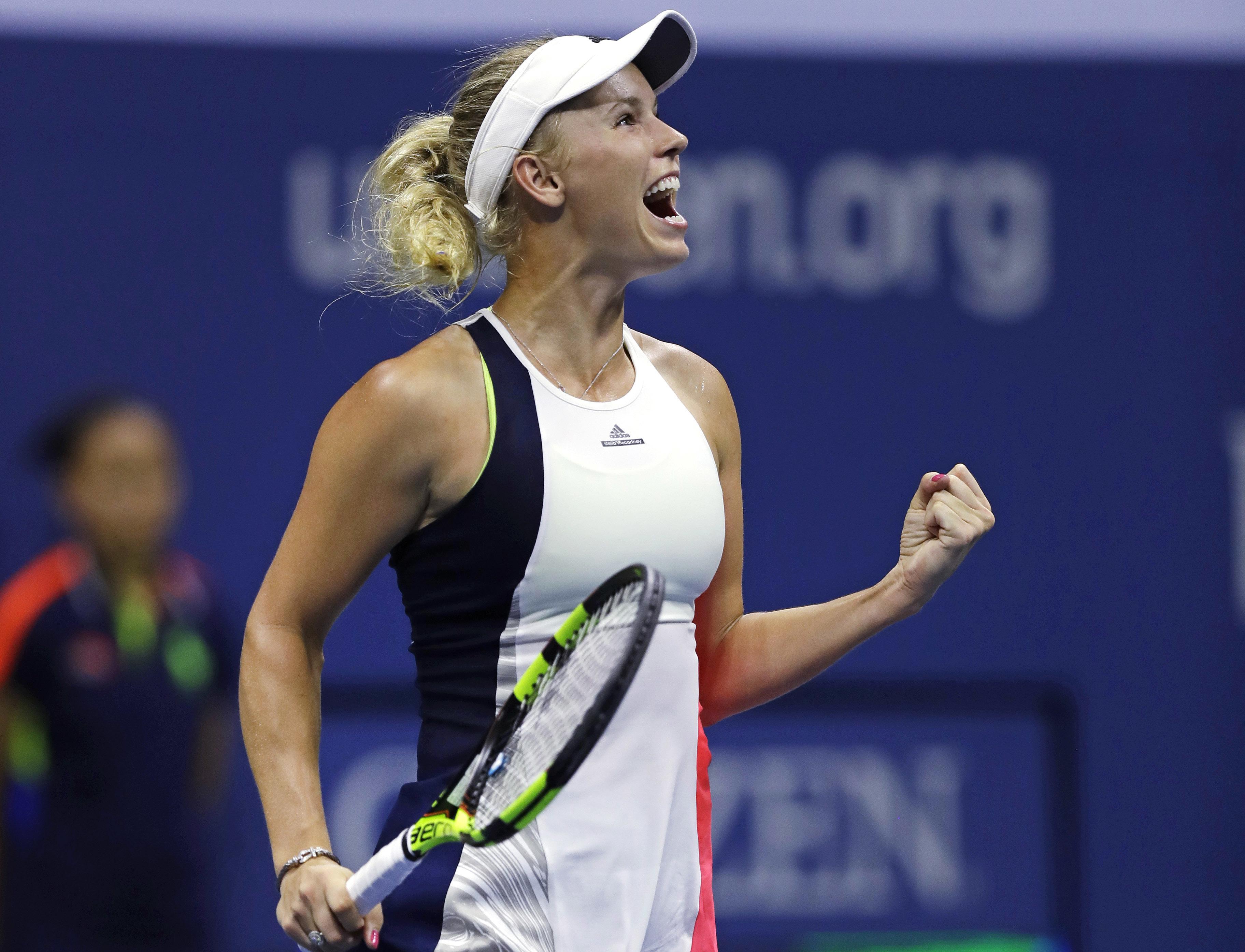Caroline Wozniacki, of Denmark, pumps her fist after defeating Anastasija Sevastova, of Latvia, 6-0, 6-2 during a quarterfinal at the U.S. Open tennis tournament, Tuesday, Sept. 6, 2016, in New York. (AP Photo/Charles Krupa)