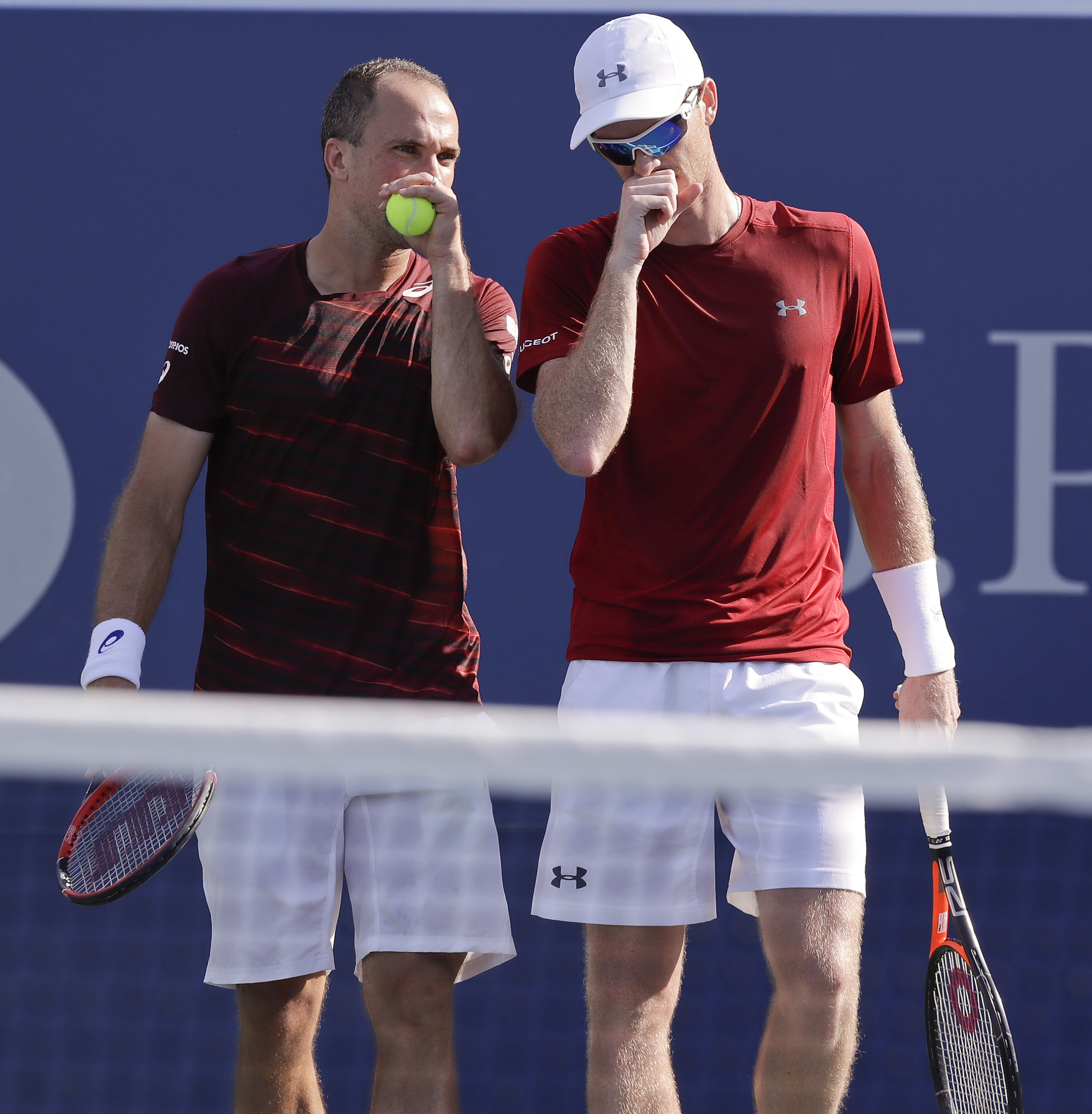 Bruno Soares, of Brazil, left, talks with doubles partner Jamie Murray, of the United Kingdom, during the men's doubles semifinals against Pierre-Hugues Herbert, of France, and Nicolas Mahut, of France, at the U.S. Open tennis tournament, Thursday, Sept.