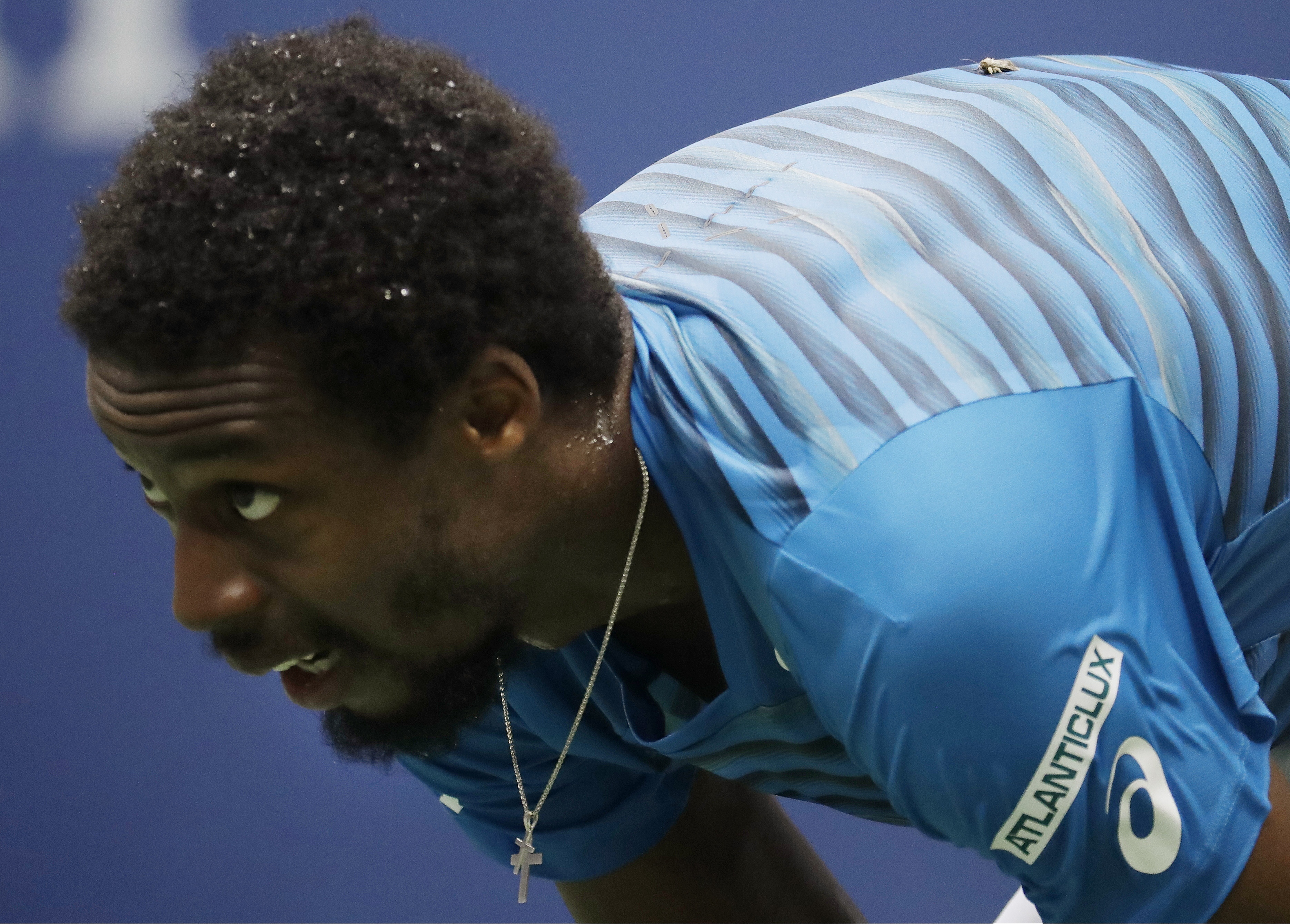 Gael Monfils, of France, prepares for a serve from Novak Djokovic, of Serbia, during the semifinals of the U.S. Open tennis tournament, Friday, Sept. 9, 2016, in New York. (AP Photo/Julio Cortez)