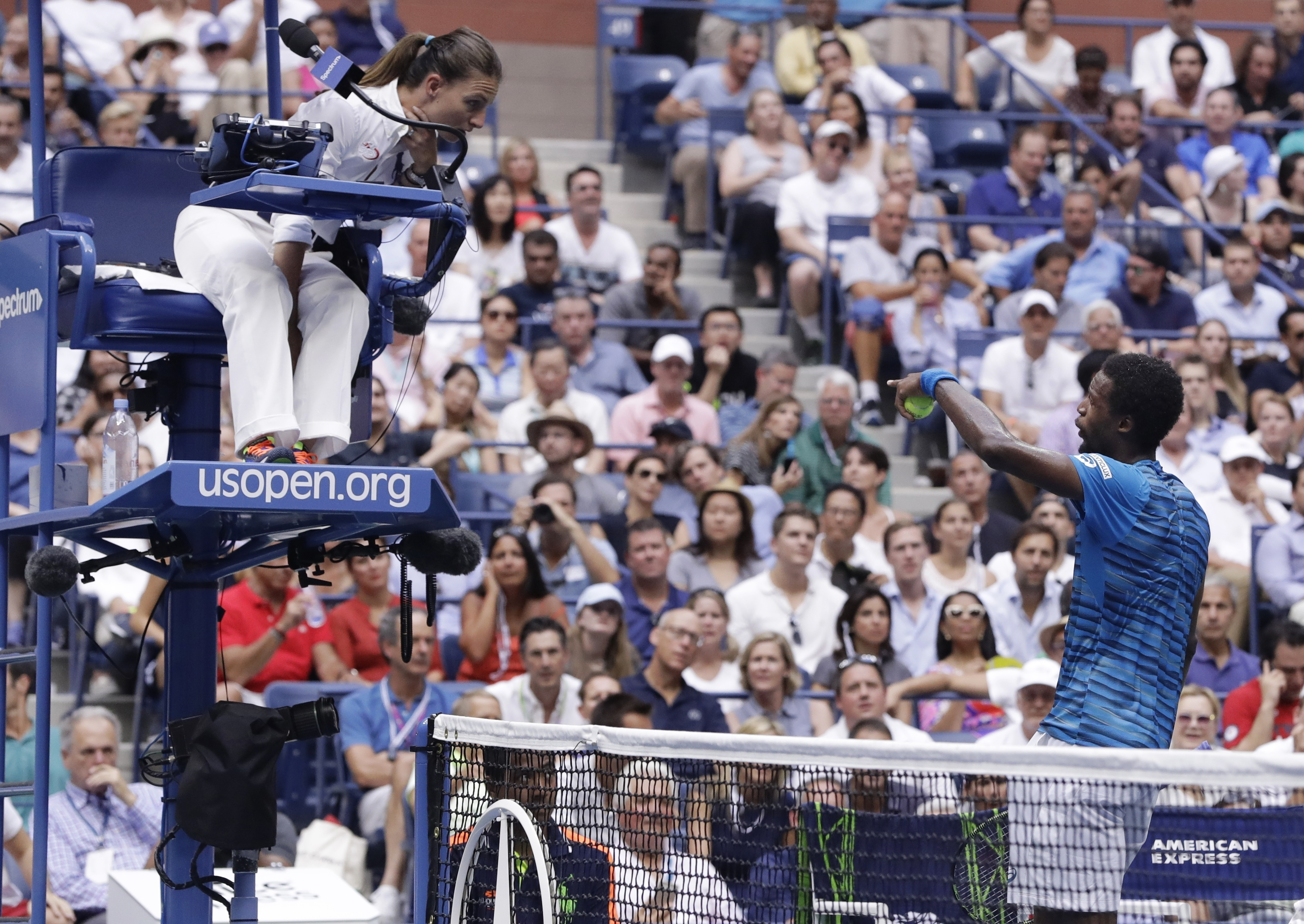 Gael Monfils, of France, talks with the chair umpire during the semifinals of the U.S. Open tennis tournament against Novak Djokovic, of Serbia, Friday, Sept. 9, 2016, in New York. (AP Photo/Darron Cummings)