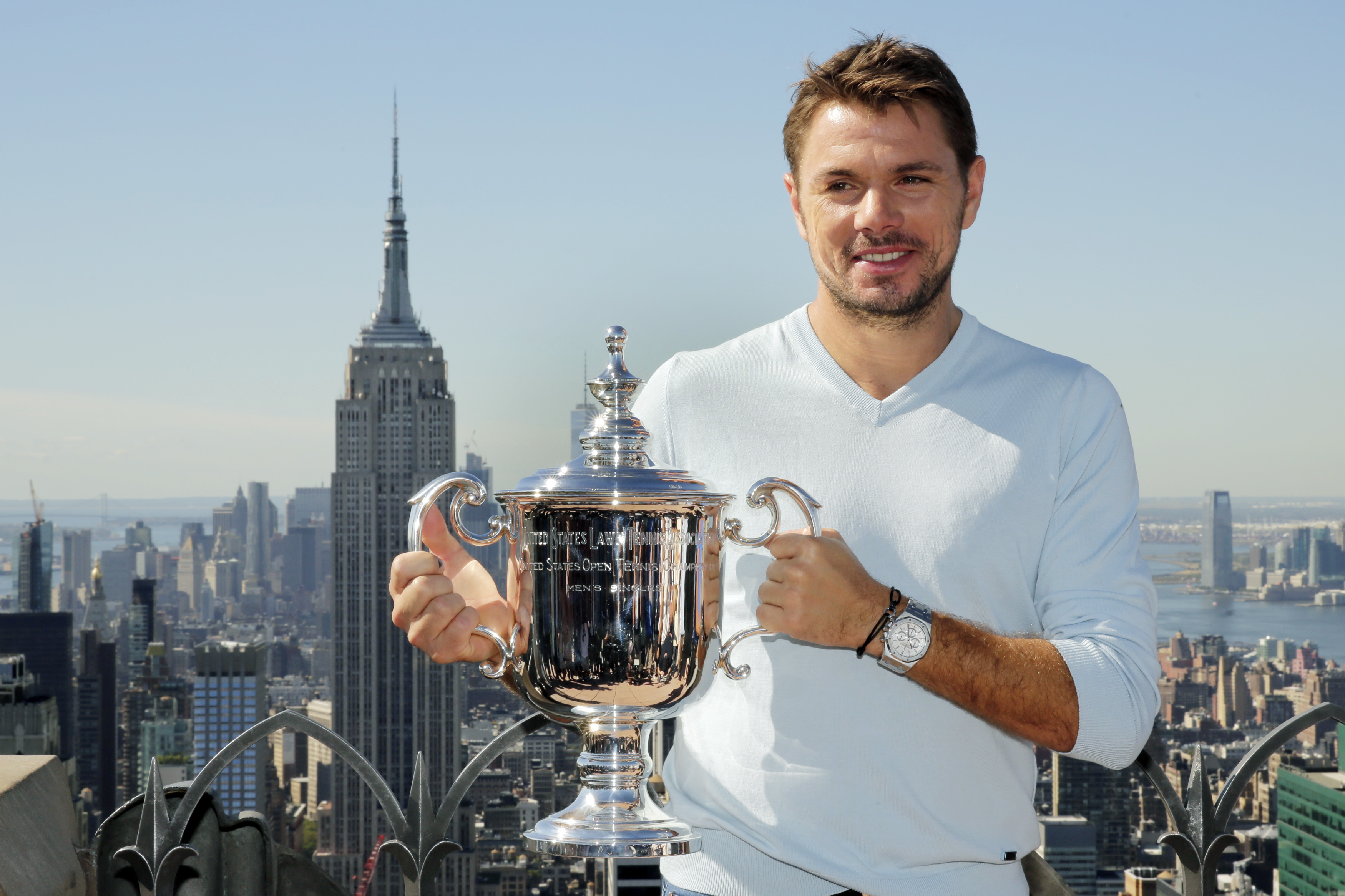 "U.S. Open men's singles tennis champion Stan Wawrinka poses for photos at the ""Top of the Rock,"" in New York's Rockefeller Center, Monday, Sept. 12, 2016. Wawrinka wore down Novak Djokovic and beat the defending champion 6-7 (1), 6-4, 7-5, 6-3 on Sunday f"